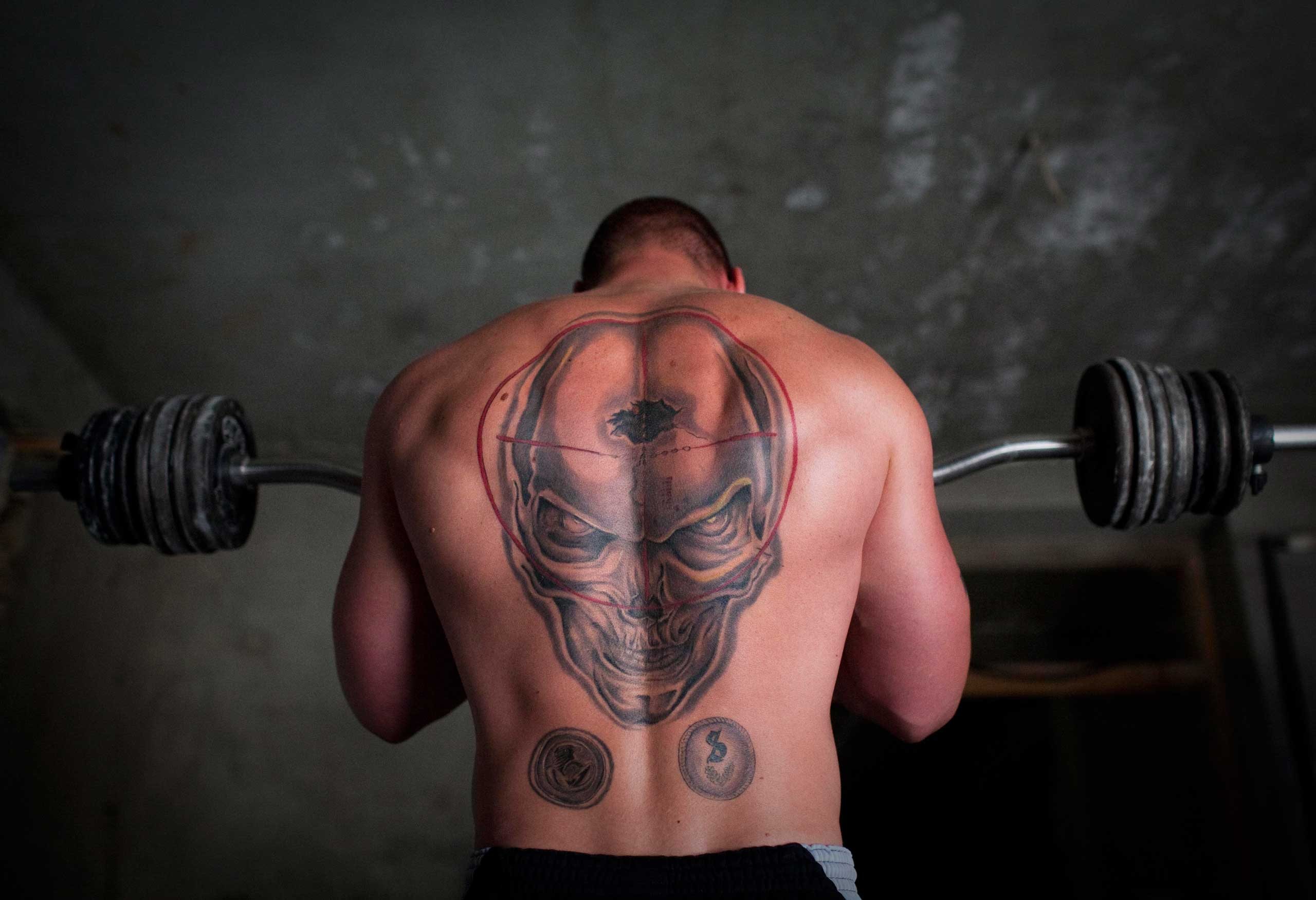 A German soldier lifts weights at his combat outpost in Char Darah, outisde Kunduz, Afghanistan, Sept. 17, 2011.