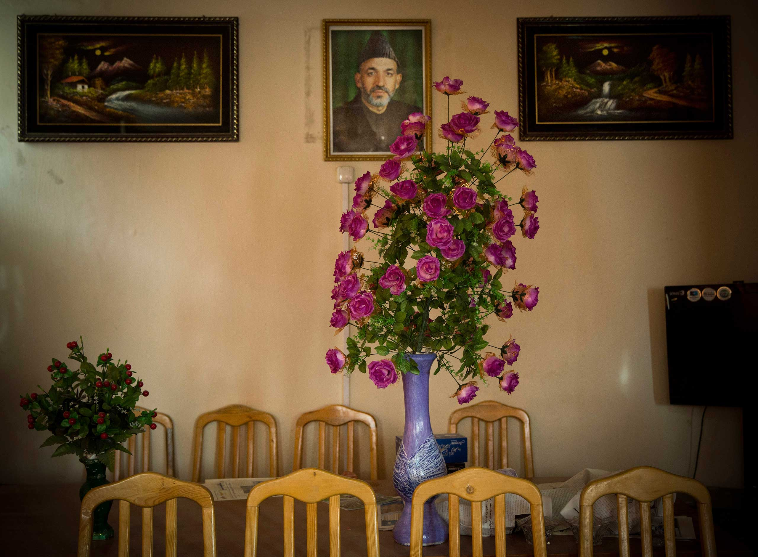 A picture of Afghan President Hamid Karzai hangs on a wall in the main room of the district municipality in eastern Kabul, March 29, 2014.