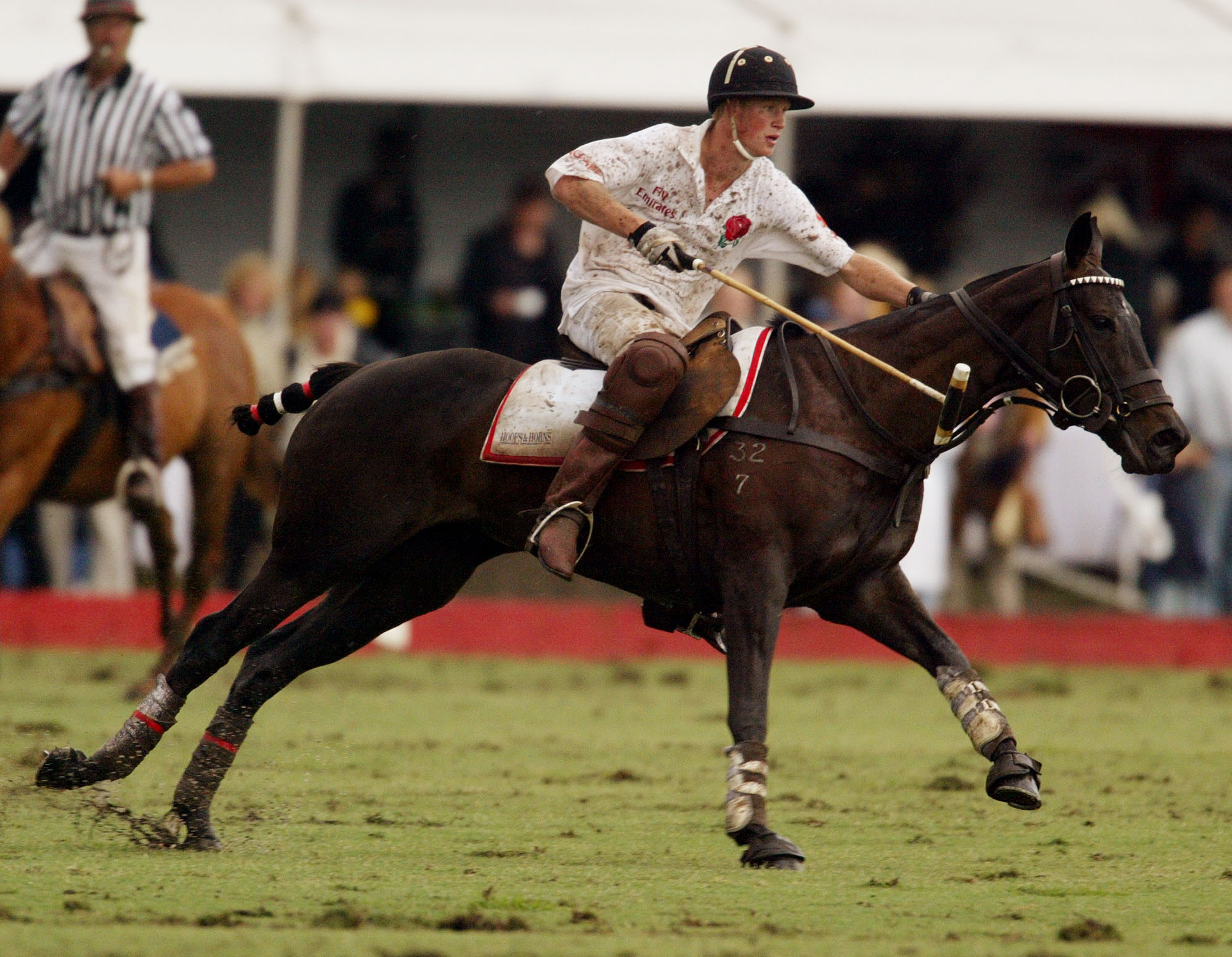 Prince Harry chases after the ball during the Young England Team against the Young Australian Team polo match in Richmond, Australia on Nov. 23, 2003.