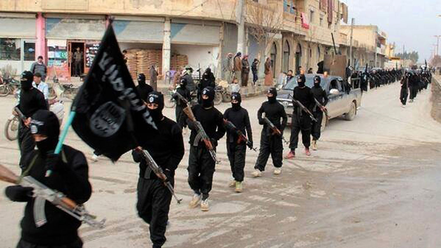 Fighters from the Islamic State of Iraq and Greater Syria marching in Raqqa, Syria, on Jan. 14, 2014