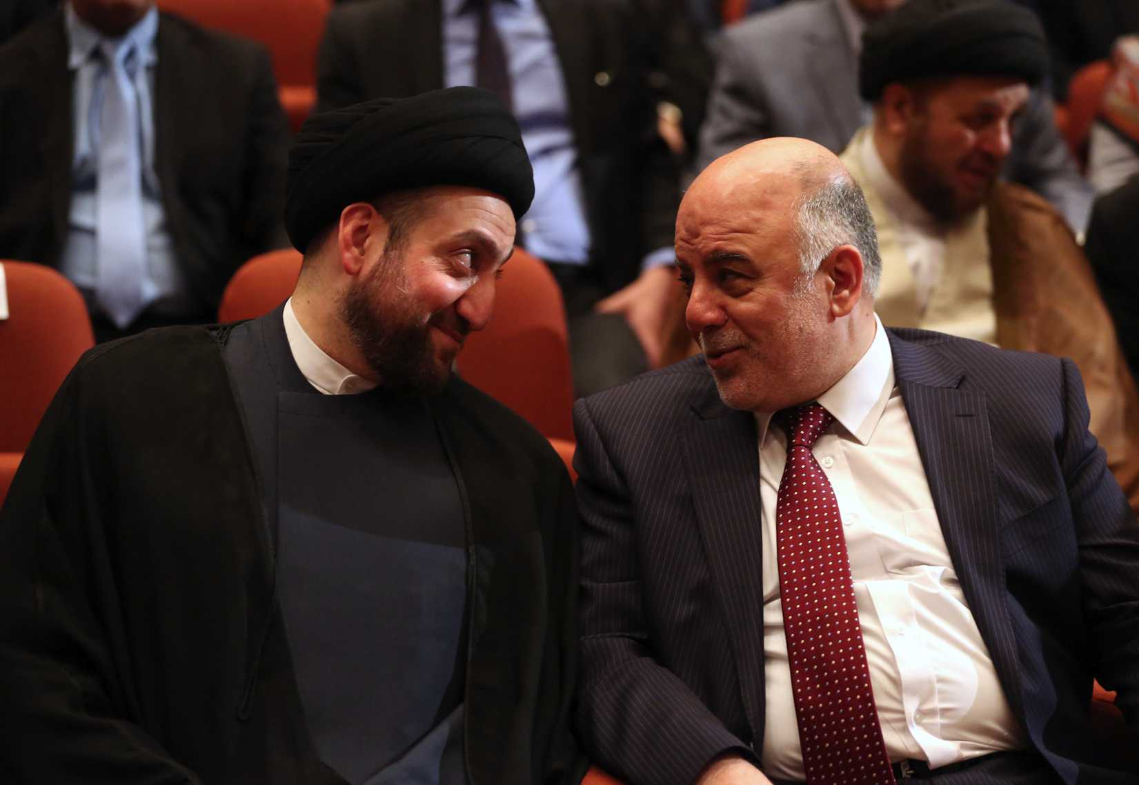 Iraq's new Prime Minister Haider al-Abadi, right, and Ammar al-Hakim, left, the leader of the Supreme Islamic Council of Iraq, during the session to approve the new government in Baghdad on Sept. 8, 2014