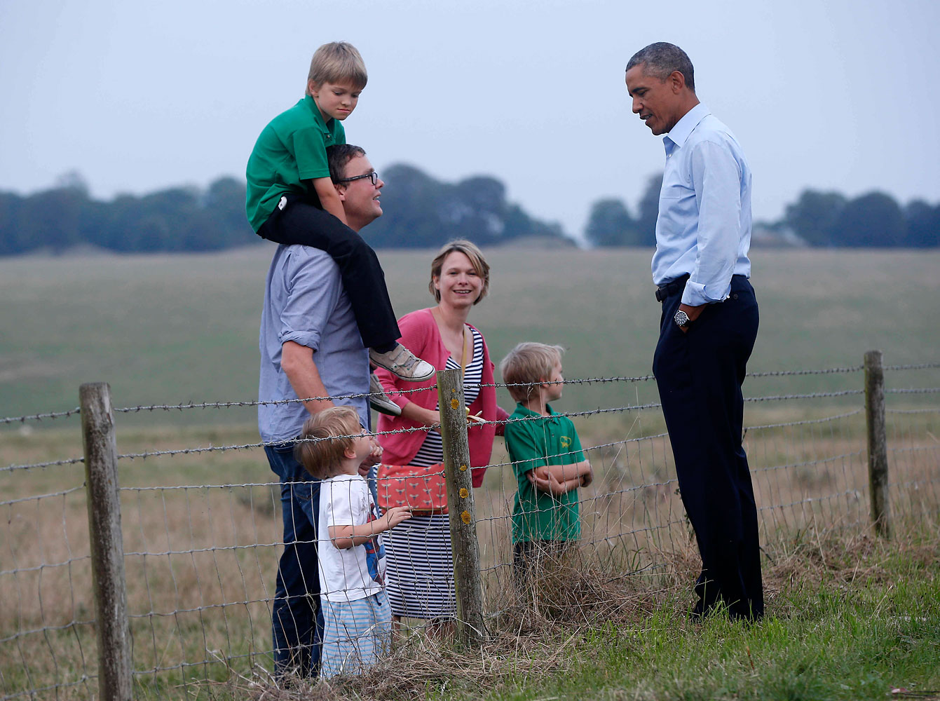 President Barack Obama meets a family in a field as he visits Stonehenge after leaving the NATO summit in Newport, Wales, Friday, Sept. 5, 2014. (AP Photo/Charles Dharapak)