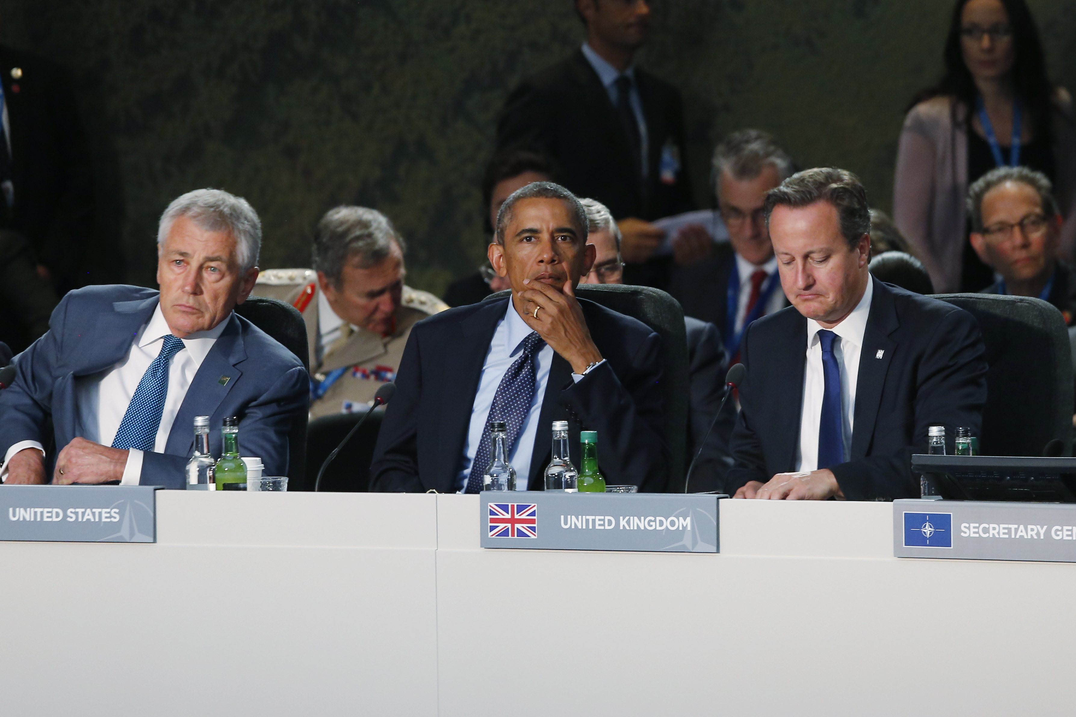 U.S. President Barack Obama, center, U.S. Secretary of Defense Chuck Hagel , left, and British Prime Minister David Cameron are seated during a leaders meeting on the future of NATO at Celtic Manor in Newport, Wales, Friday, Sept. 5, 2014.