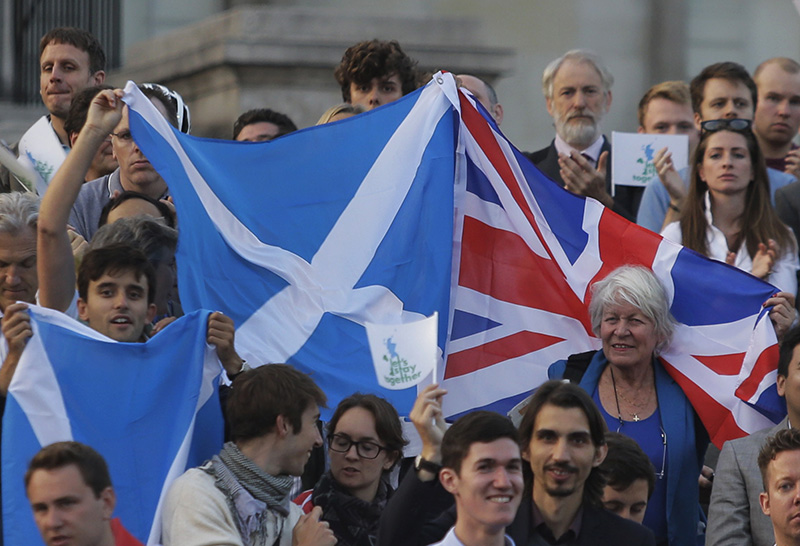 Supporters wave British and Scottish flags at a pro-union rally, at Trafalgar Square in central London on Sept. 15, 2014
