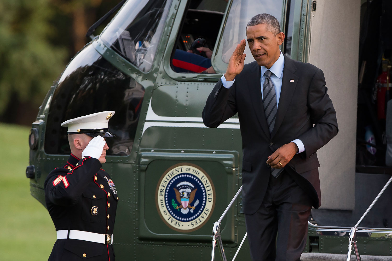President Barack Obama salutes as he arrives on the South Lawn of the White House, in Washington, D.C., on Sept. 12, 2014