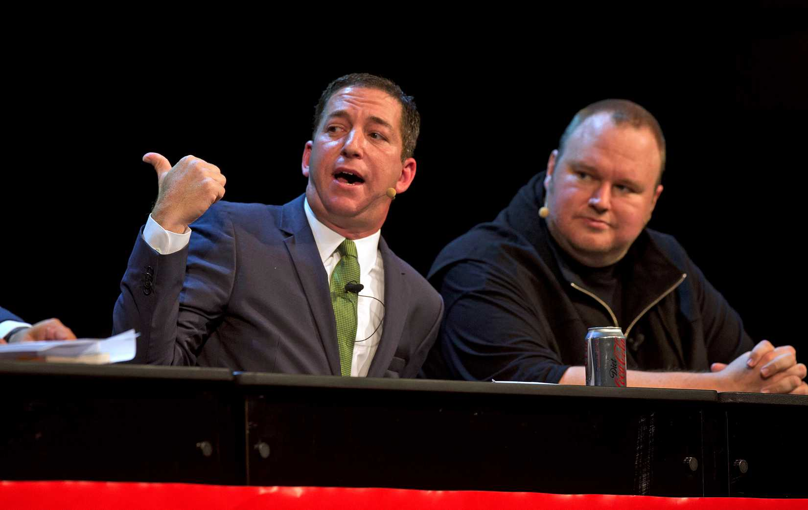 Journalist and author Glenn Greenwald, left, and Kim Dotcom attend a political forum at in Auckland on Sept. 15, 2014