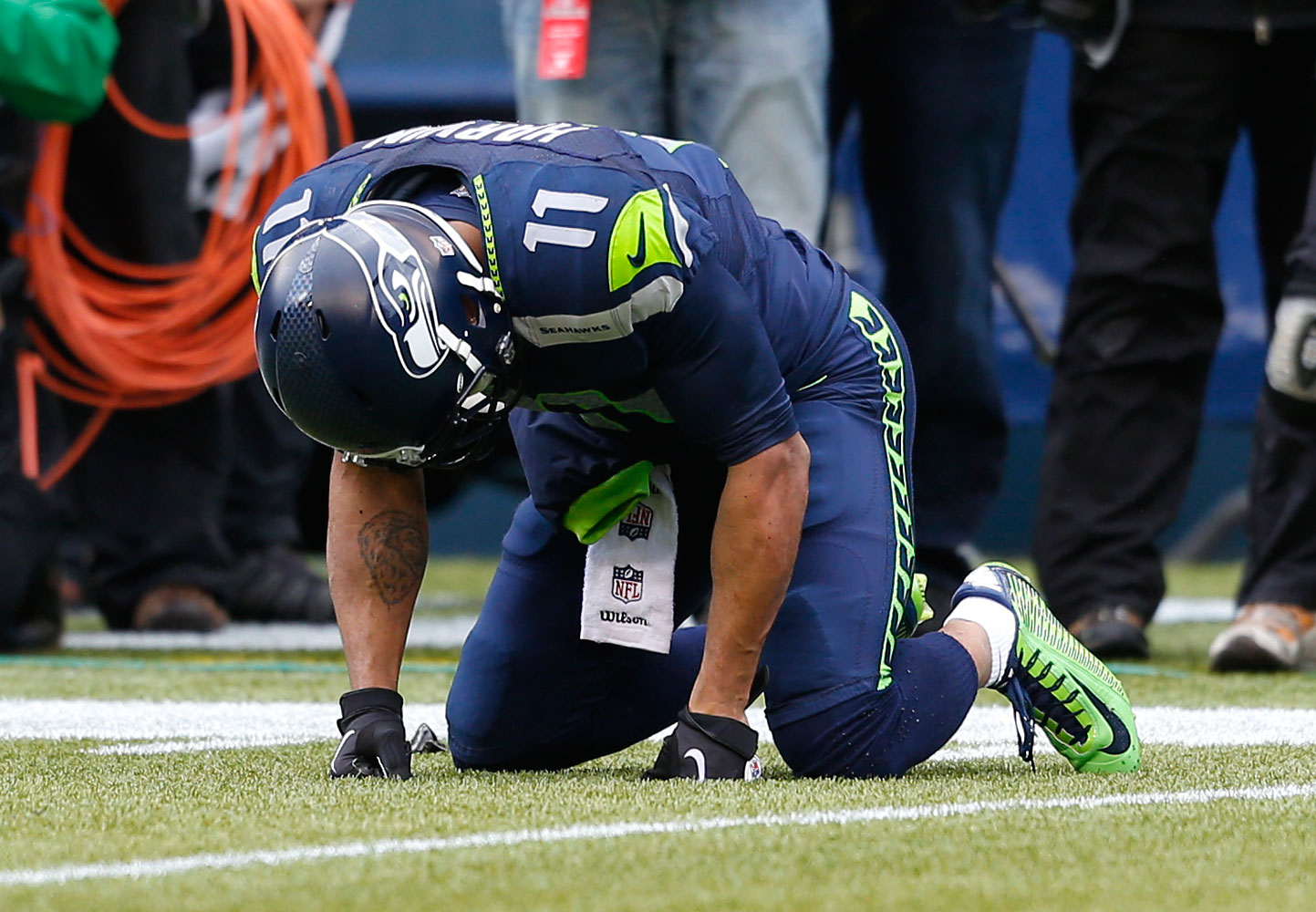 Seattle Seahawks wide receiver Percy Harvin (11) reacts after taking a big hit during an NFL Divisional Playoff game against the New Orleans Saints on Jan. 11, 2014.