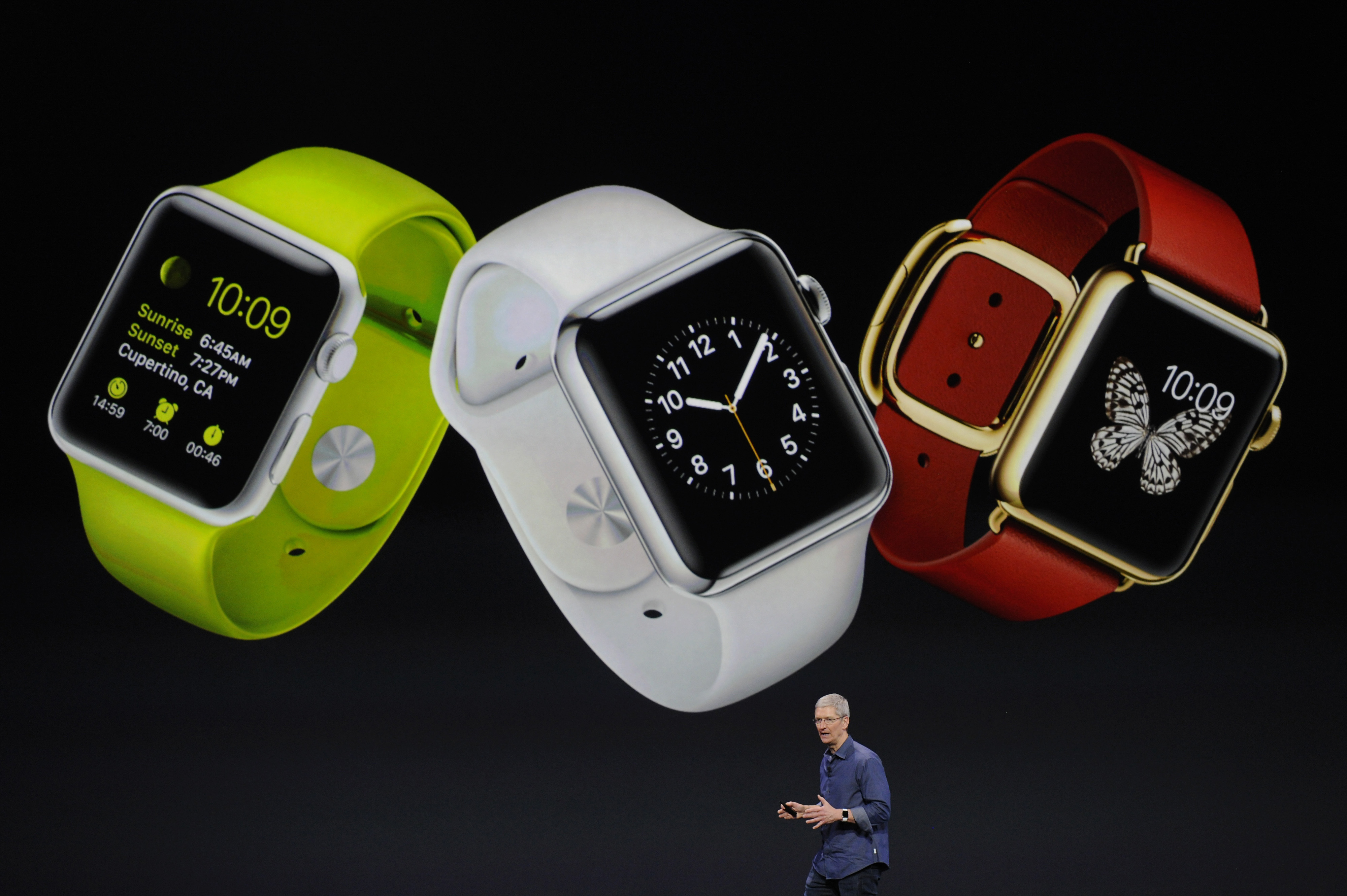 Tim Cook, chief executive officer of Apple Inc., unveils the Apple Watch during a product announcement at Flint Center in Cupertino, California, U.S., on Tuesday, Sept. 9, 2014.