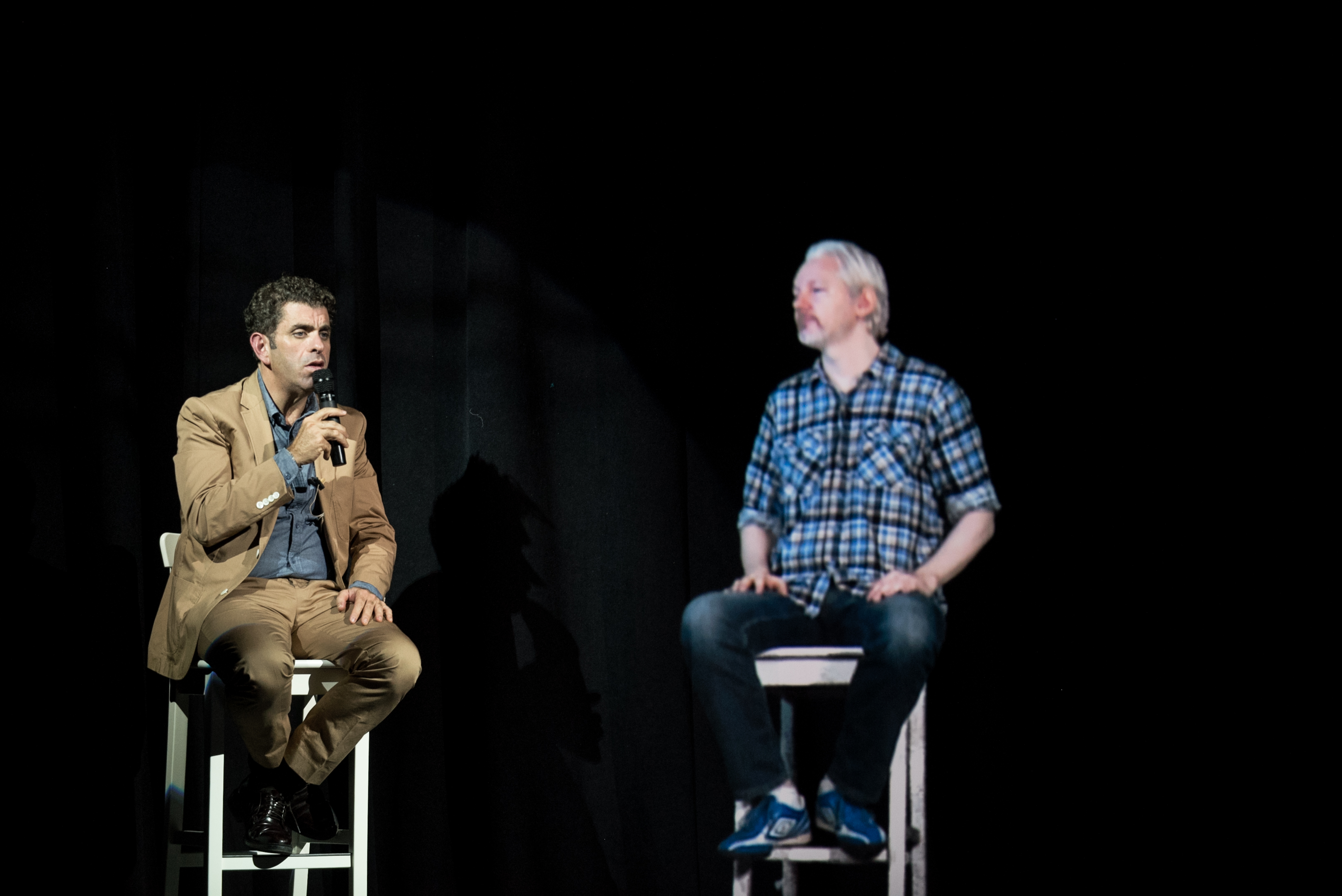 Julian Assange appears by hologram at The Nantucket Project on Sept. 28, 2014, alongside Eugene Jarecki.