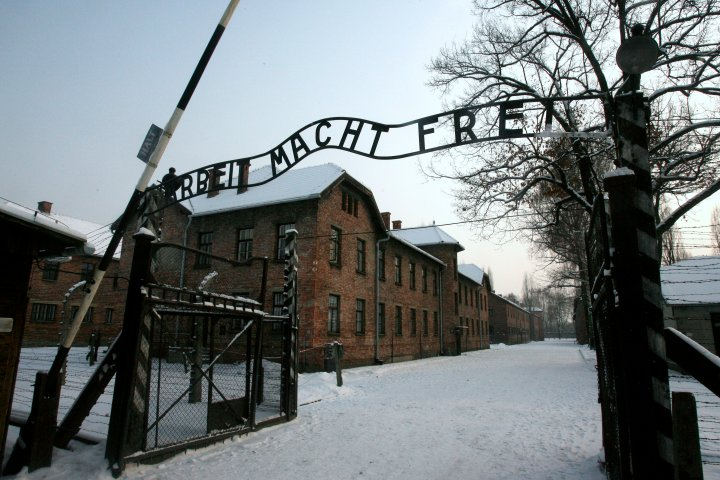 """A replica hung in place of the stolen infamous """"Arbeit macht frei"""" sign at the former Nazi death camp Auschwitz in Oswiecim, Poland on Dec. 18, 2009."""