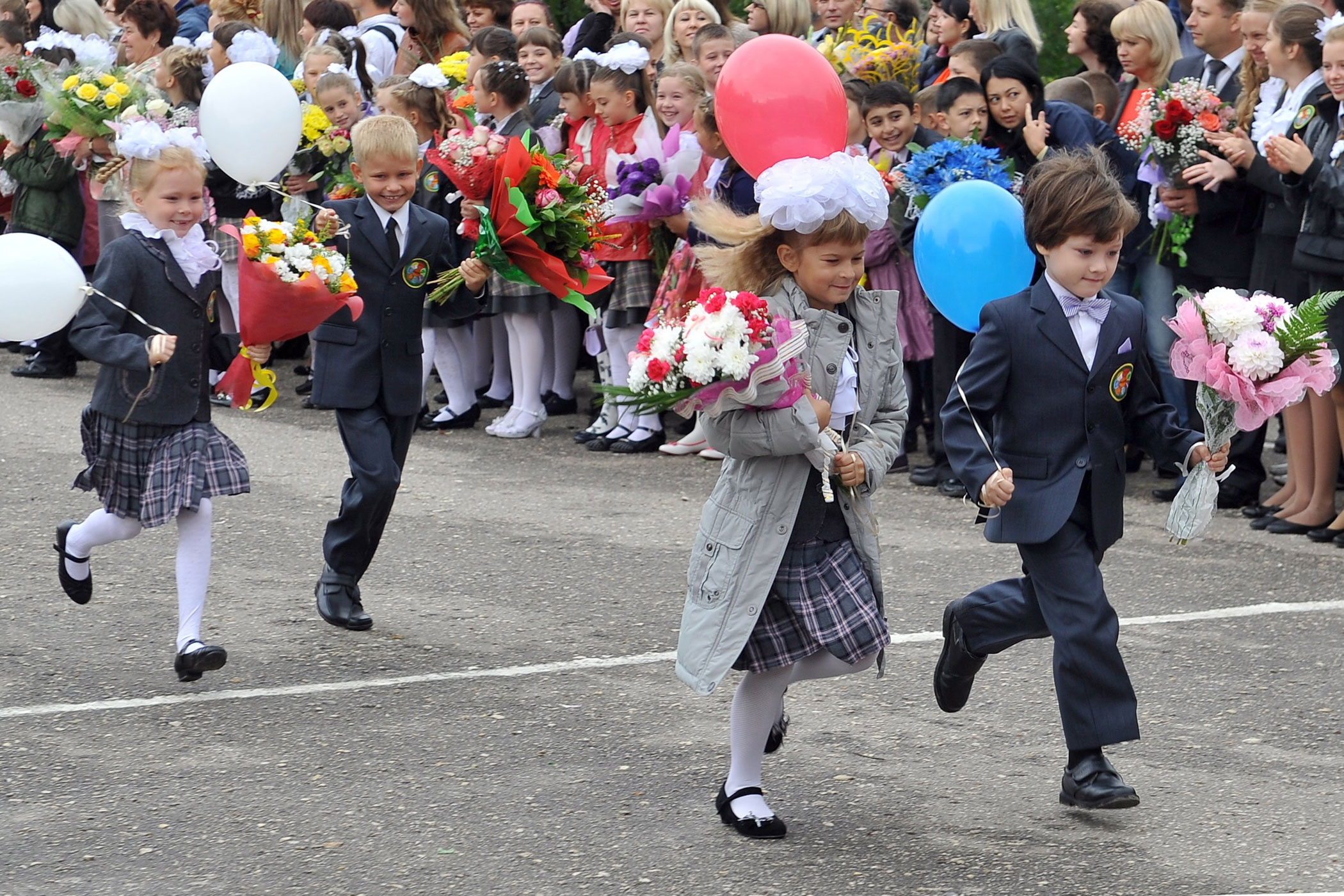 First grade students line up at school during the start of a new school year on Knowledge Day in Ryazan, Russia on Sept. 32, 2014.