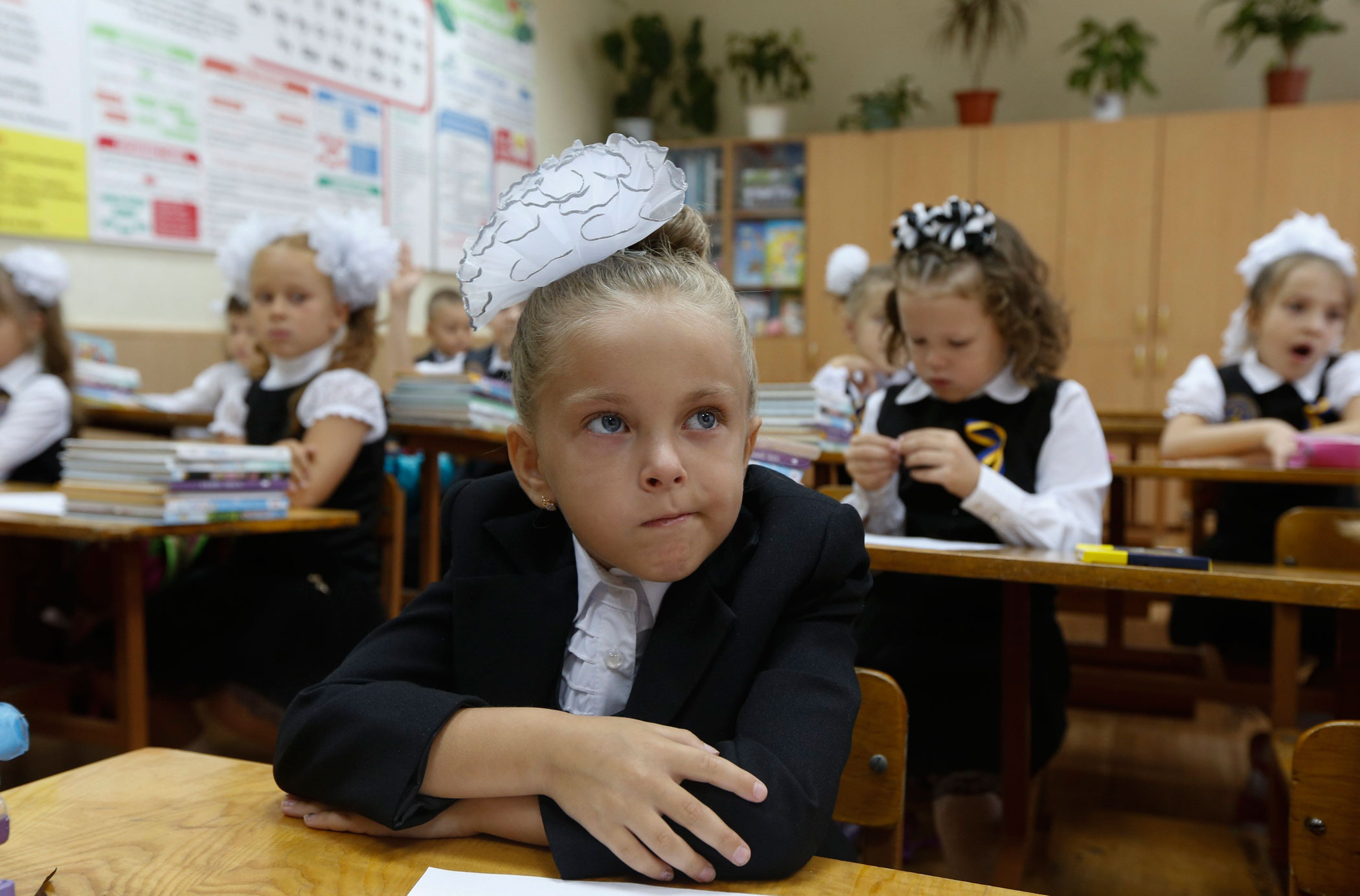 Students attend their first lesson of the day in a school in the southern coastal town of Mariupol, Ukraine on Sept. 1, 2014.