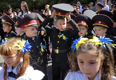Ukrainian children from cadet's lyceum attend the first day of school, which marks the traditional start of the academic year in Kiev, Ukraine on Sept. 1, 2014.