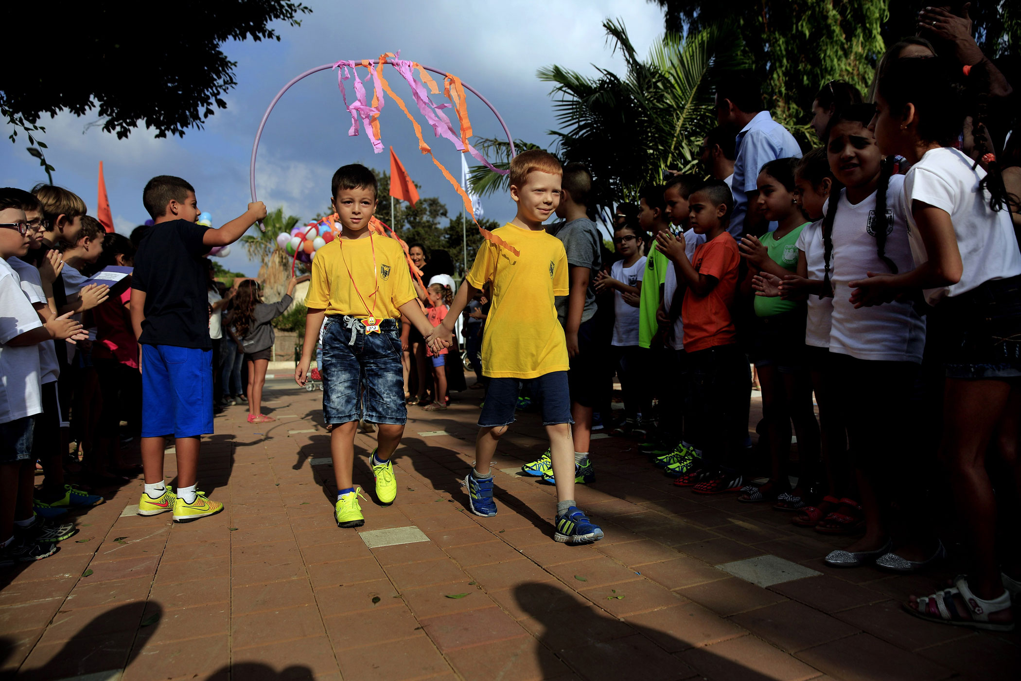 Children hold hands during the first day of school in the costal city of Ashkelon, Israel on Sept. 1, 2014.