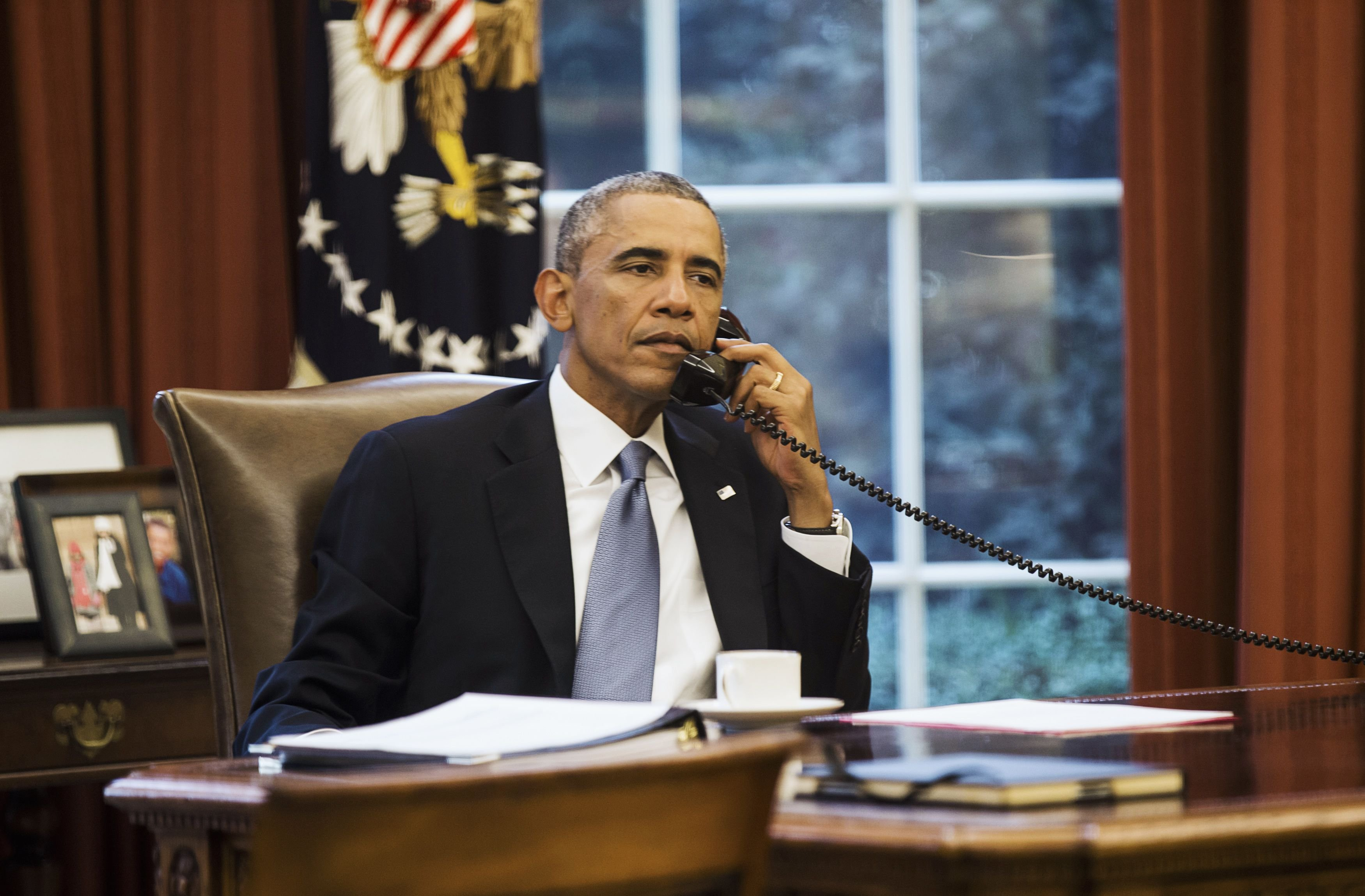 U.S. President Barack Obama speaks on the phone with Saudi Arabia's King Abdullah, before giving a speech to the nation regarding the fight against ISIS, from the Oval Office of the White House, in Washington on Sept. 10, 2014.