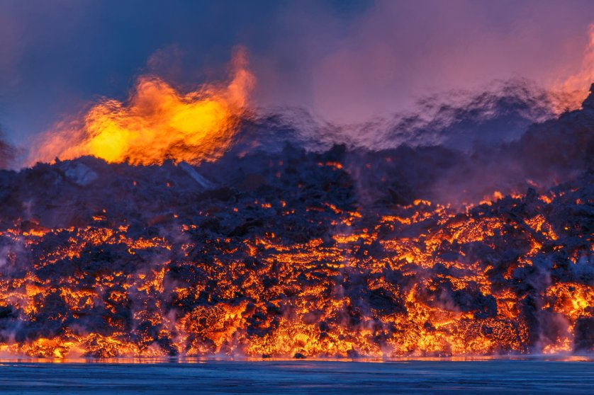 Creeping lava and a mirage from the heat distorting the view of the lava fountains in the distance. The heat may be over 1000 degrees Celsius. Bardarbunga, Sept. 2, 2014.