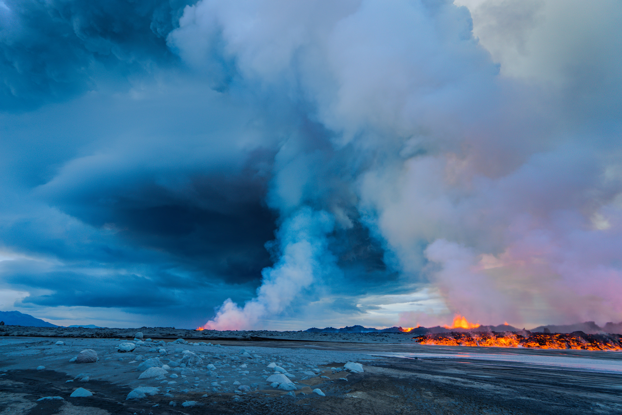 A late afternoon view of part of the fissure erupting as fumes and steam rise into the air near Bardarbunga. Sept. 2.