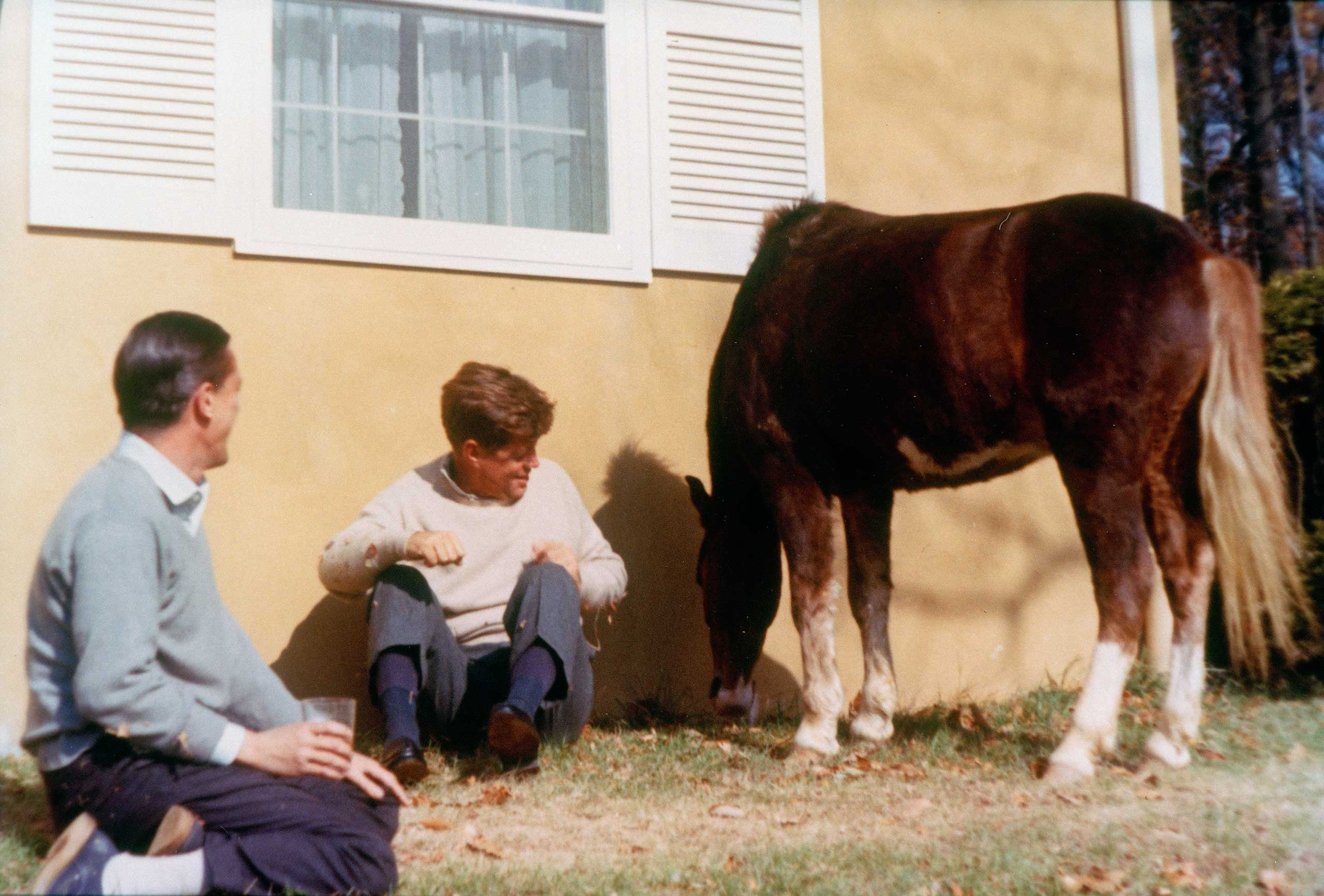From Left: Benjamin Bradlee and President John F. Kennedy sit outside of the Kennedy family residence, Wexford, on Nov. 10 1963 in Atoka, VA.