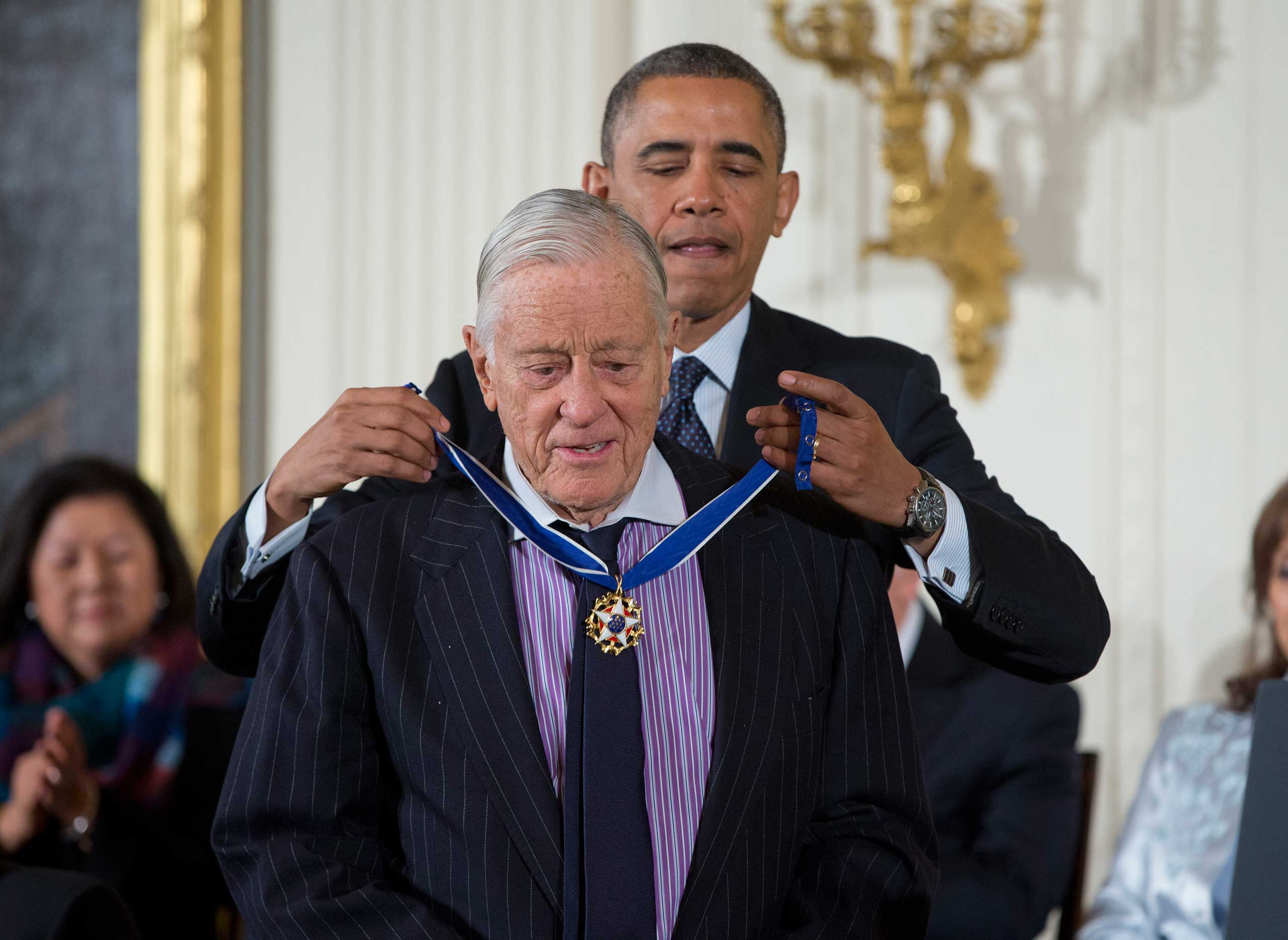 President Barack Obama awards Benjamin Bradlee with the Presidential Medal of Freedom on Nov. 20, 2013 during a ceremony in the East Room of the White House in Washington, D.C.