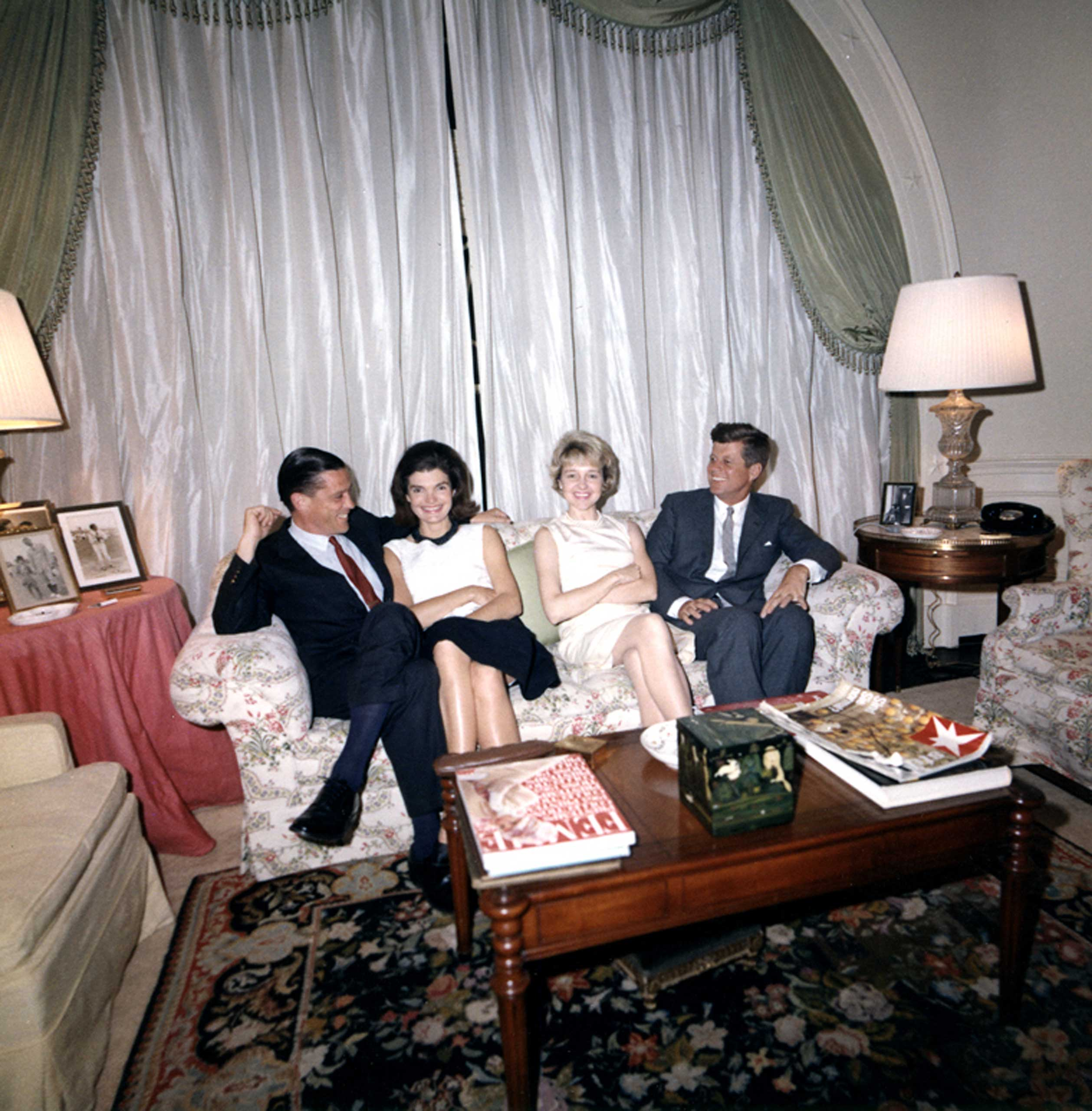 """From Left: Benjamin Bradlee, First Lady Jacqueline Kennedy, Antoinette """"Tony"""" Bradlee, and President John F. Kennedy in the White House Family Living Room on May 29, 1963 in Washington, D.C."""