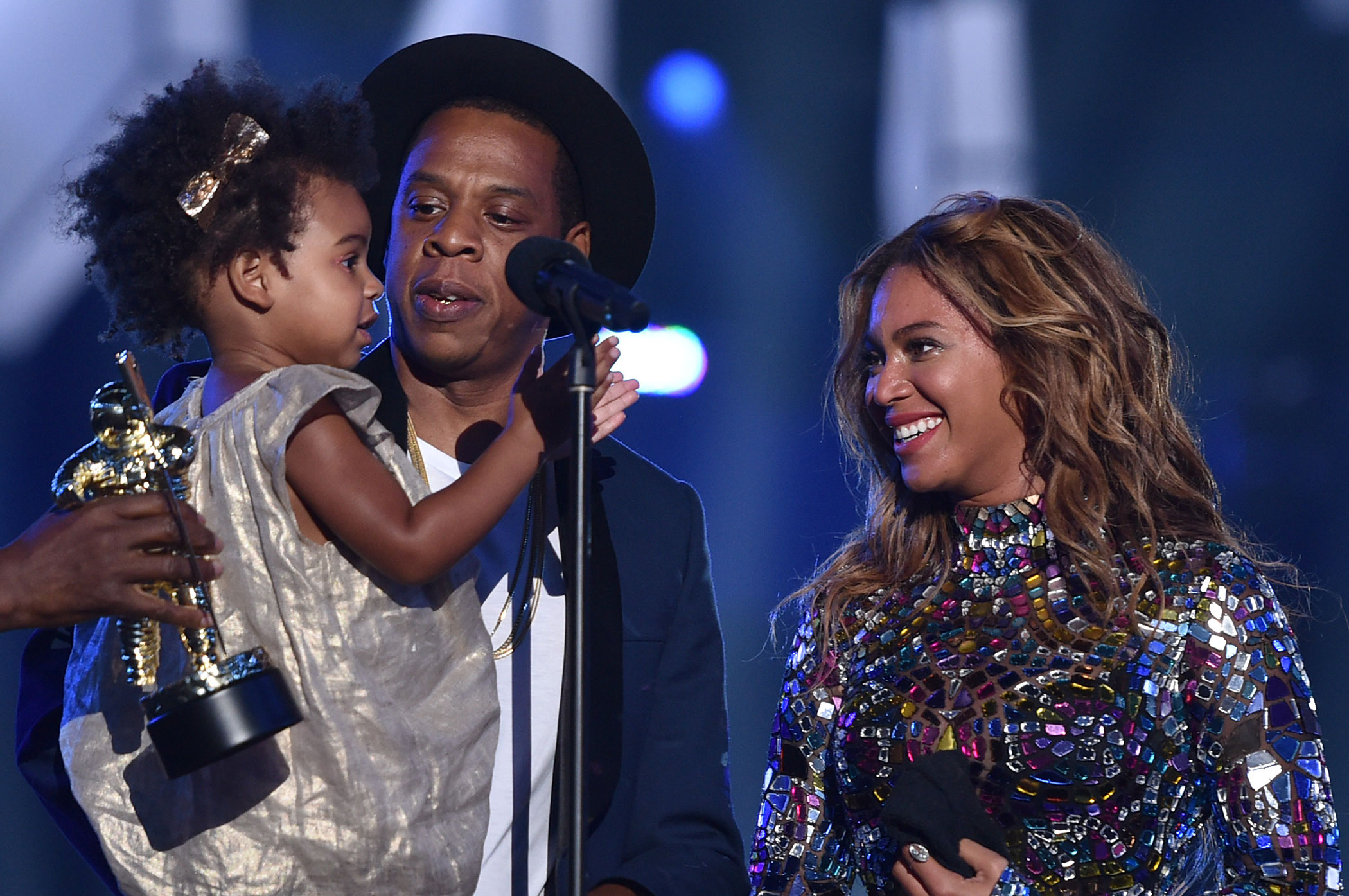 Blue Ivy Carter, Jay-Z and Beyonce speak onstage during the 2014 MTV Video Music Awards at The Forum on August 24, 2014 in Inglewood, California.