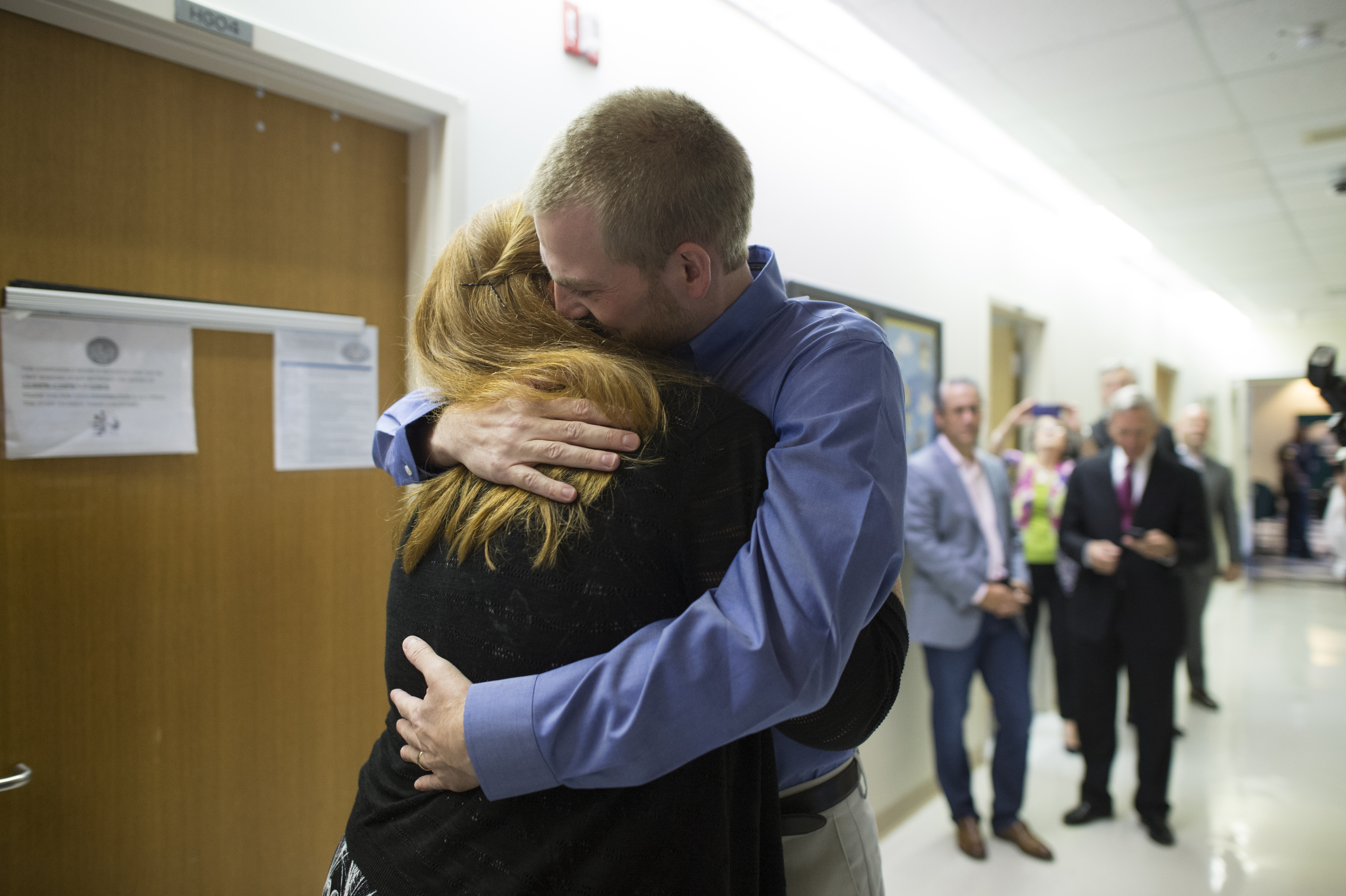 Dr. Kent Brantly hugs his wife Amber after being discharged from Emory University Hospital