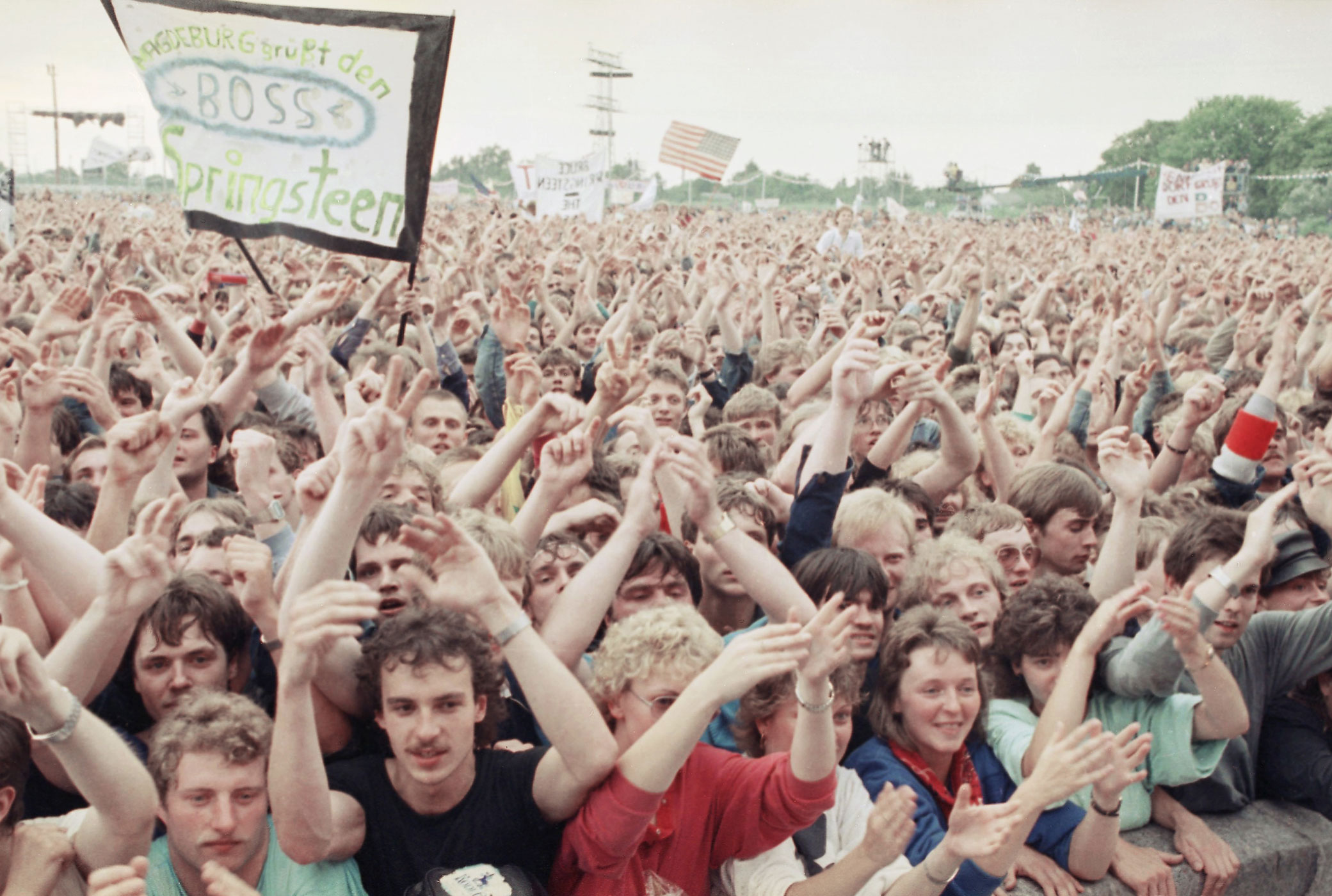 """1988:                                On July 19, Springsteen held a concert in East Germany that attracted 300,000 spectators, giving a short speech in German before launching into the song, """"Chimes of Freedom."""" """"Springsteen played an amazing concert — four hours long. It went straight to their hearts,"""" said Erik Kirschbaum, author of the book Rocking the Wall, speaking to the BBC. """"And he did mention  freedom  probably risking not being invited again — but I don't think he cared about that."""""""