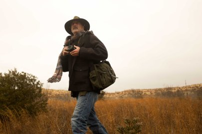Harvey shooting on location with the bag he designed for Filson