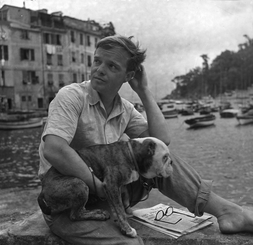 Truman Capote with his dog in 1950