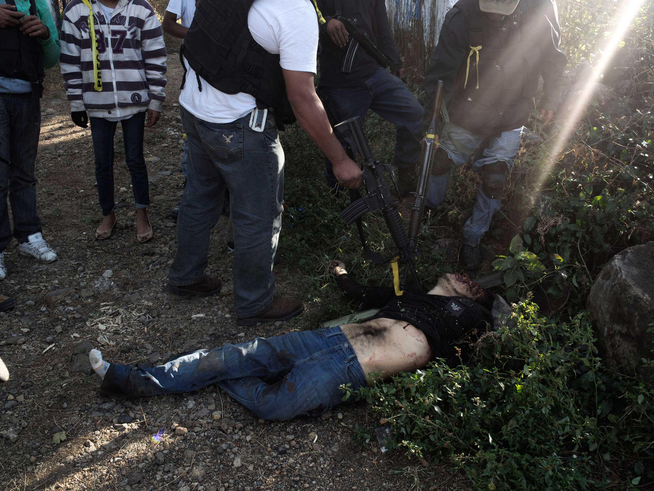 Jan. 5, 2014. A Knights Templar gunman shot dead by vigilantes during a 40-minute shootout at the entrance of Paracuaro, Michoac‡n.