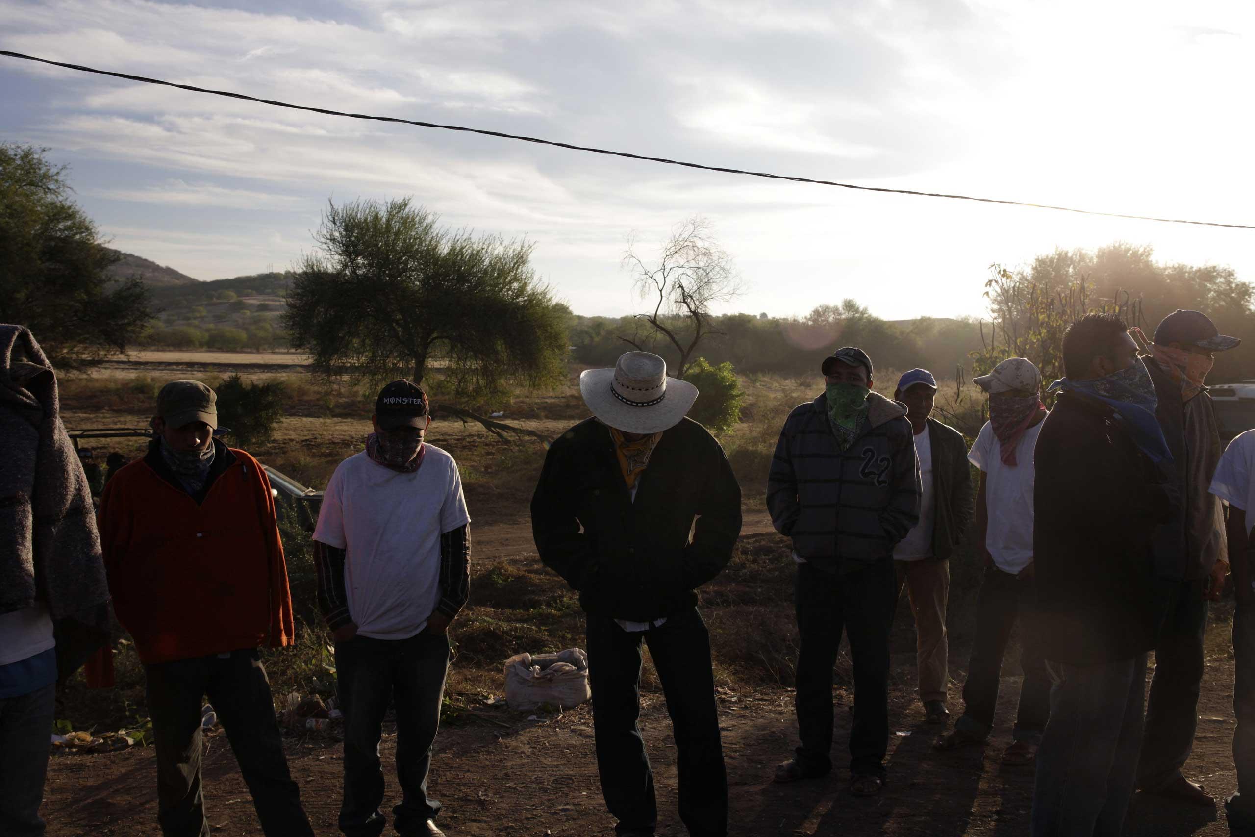 Jan. 5, 2014. Vigilantes stand at the site where JosŽ Manuel Mireles Valverde's plane crashed earlier in the week in Zicuir‡n, Michoac‡n.
