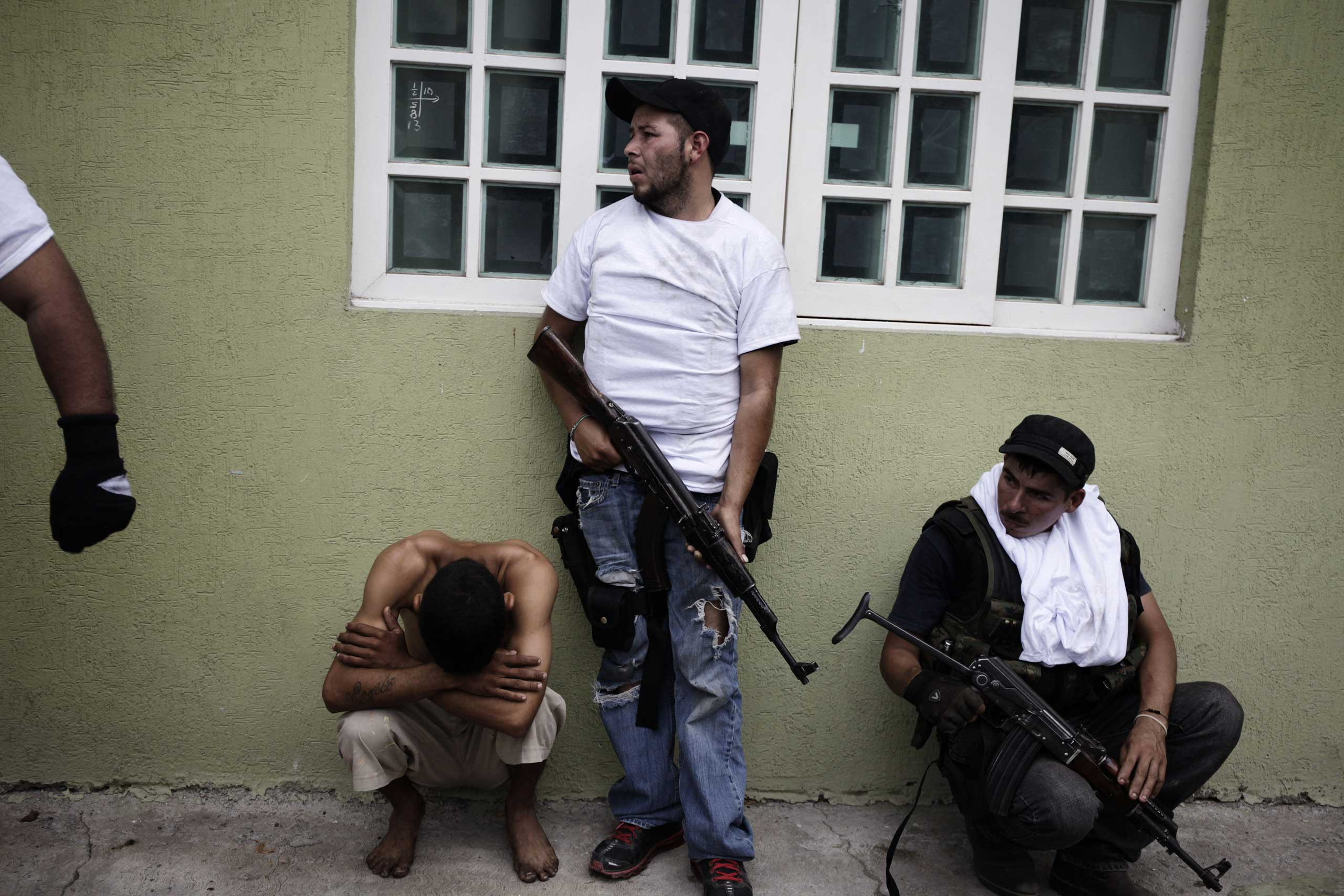 Jan. 12, 2014. A  Puntero,  or watchman, working for the Knights Templar cartel is detained by vigilantes in Nueva Italia, Michoac‡n.