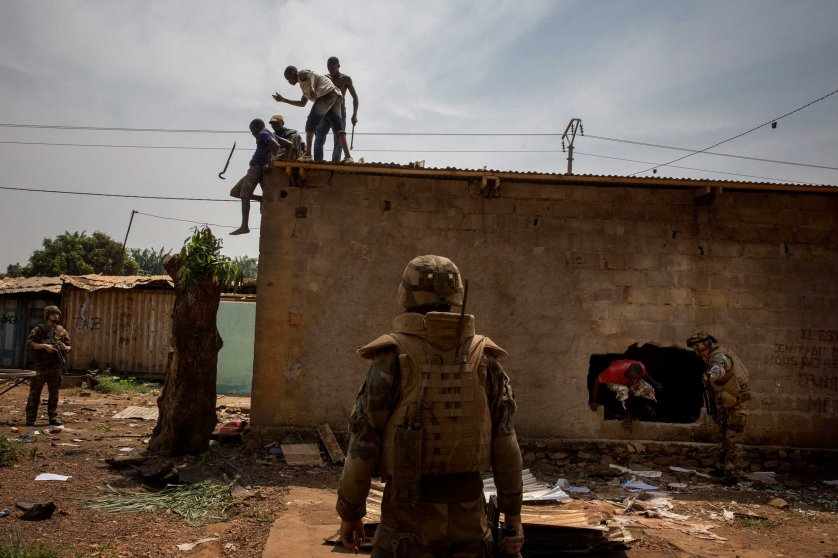 Feb. 3, 2014: French troops chase Christians looting Muslim houses in Bangui.
