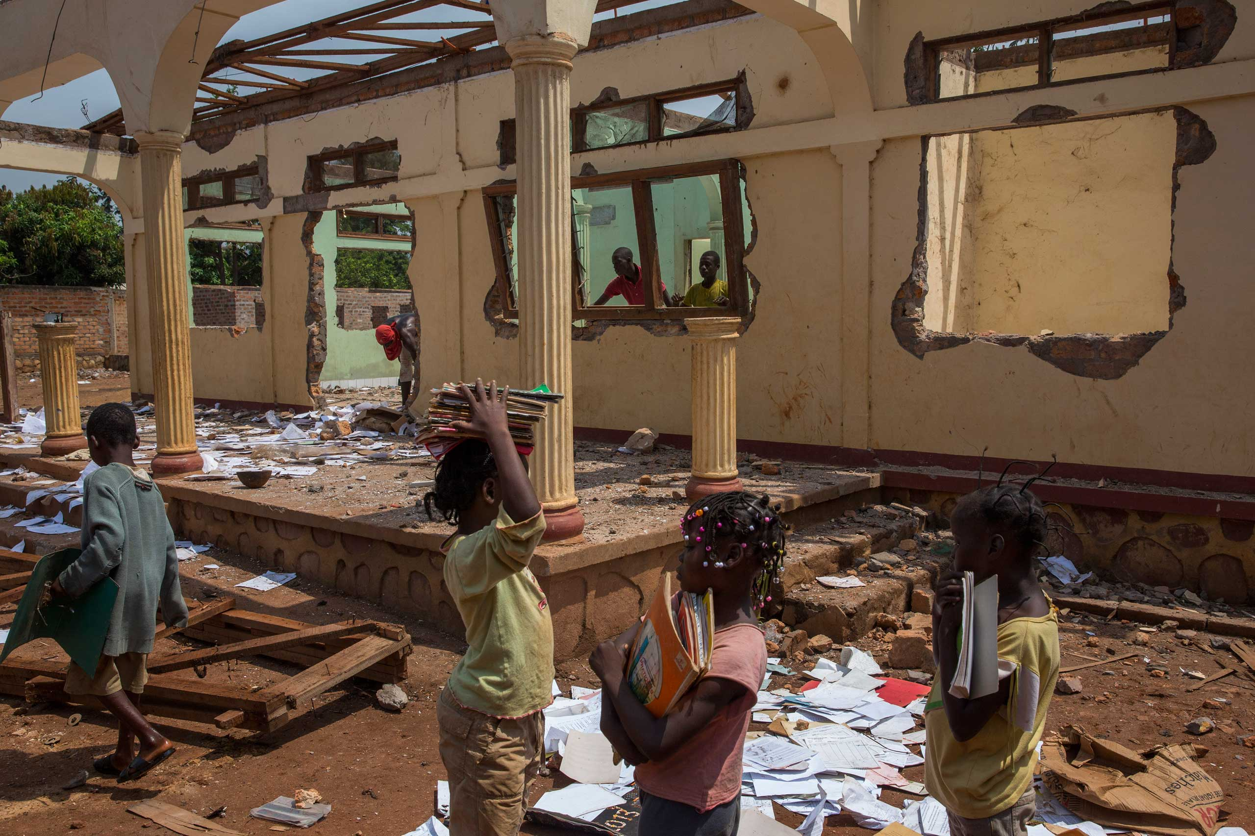 Feb. 3, 2014: Christian girls collect notebooks at a looted Muslim house in Bangui.