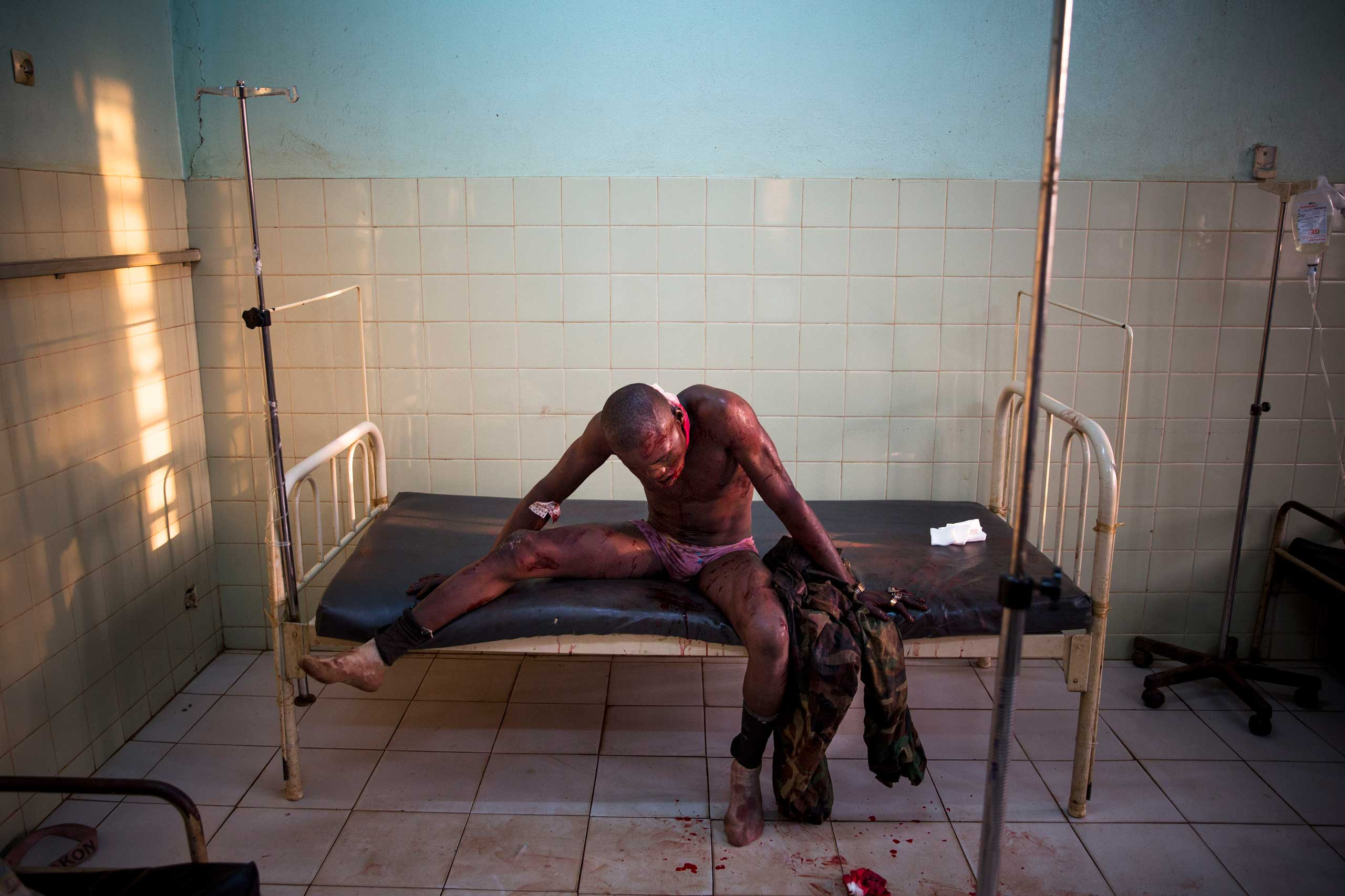 Jan. 31, 2014: A Central African soldier wounded during fighting with Muslims waits to be treated at the community hospital in Bangui.