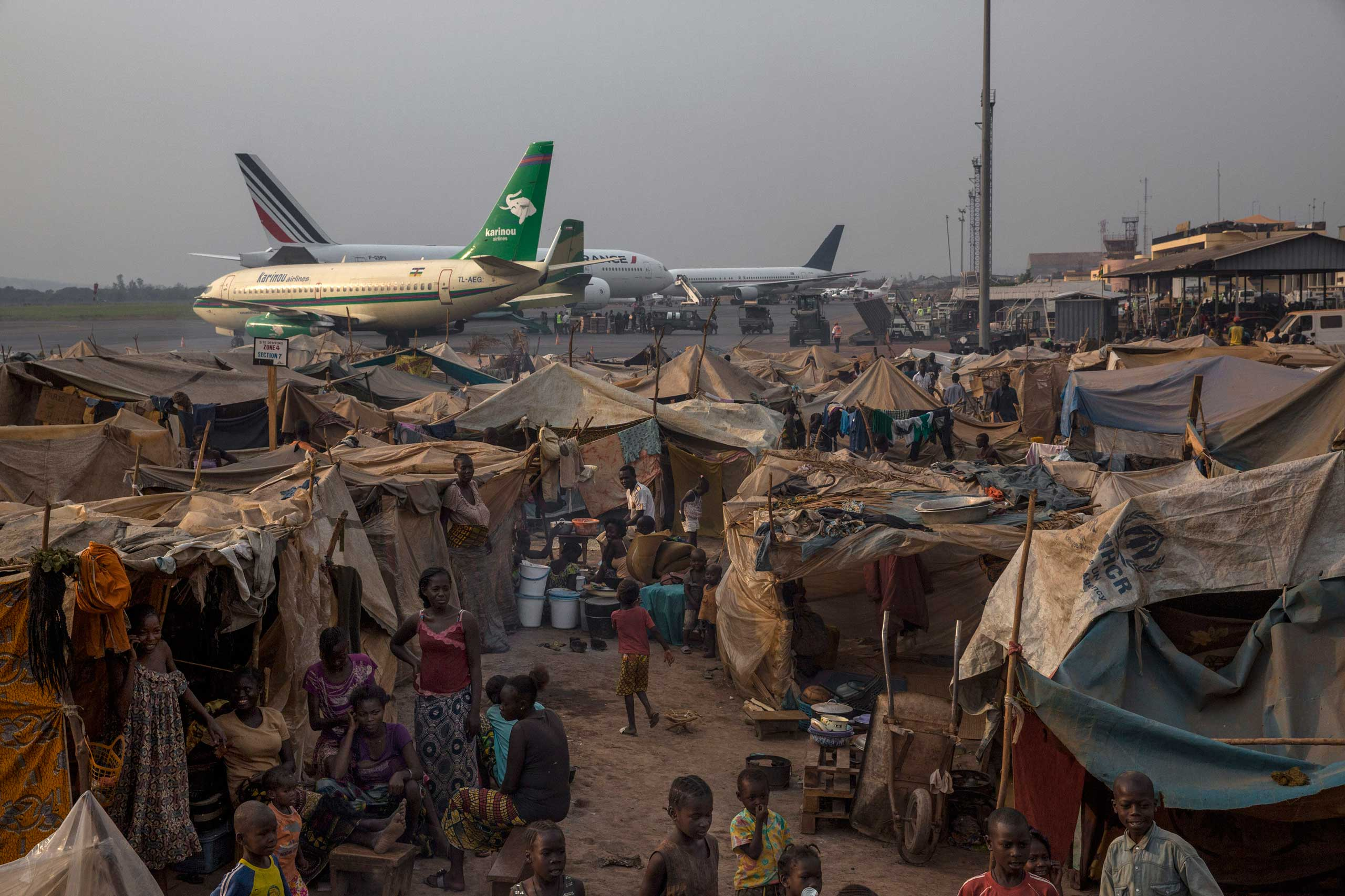 Jan. 28, 2014: The main displacement camp adjacent to Bangui's M'Poko International Airport, where thousands of people fled after the violence erupted in early December, now houses more than 100,000 people. The airport is secured by the French army.