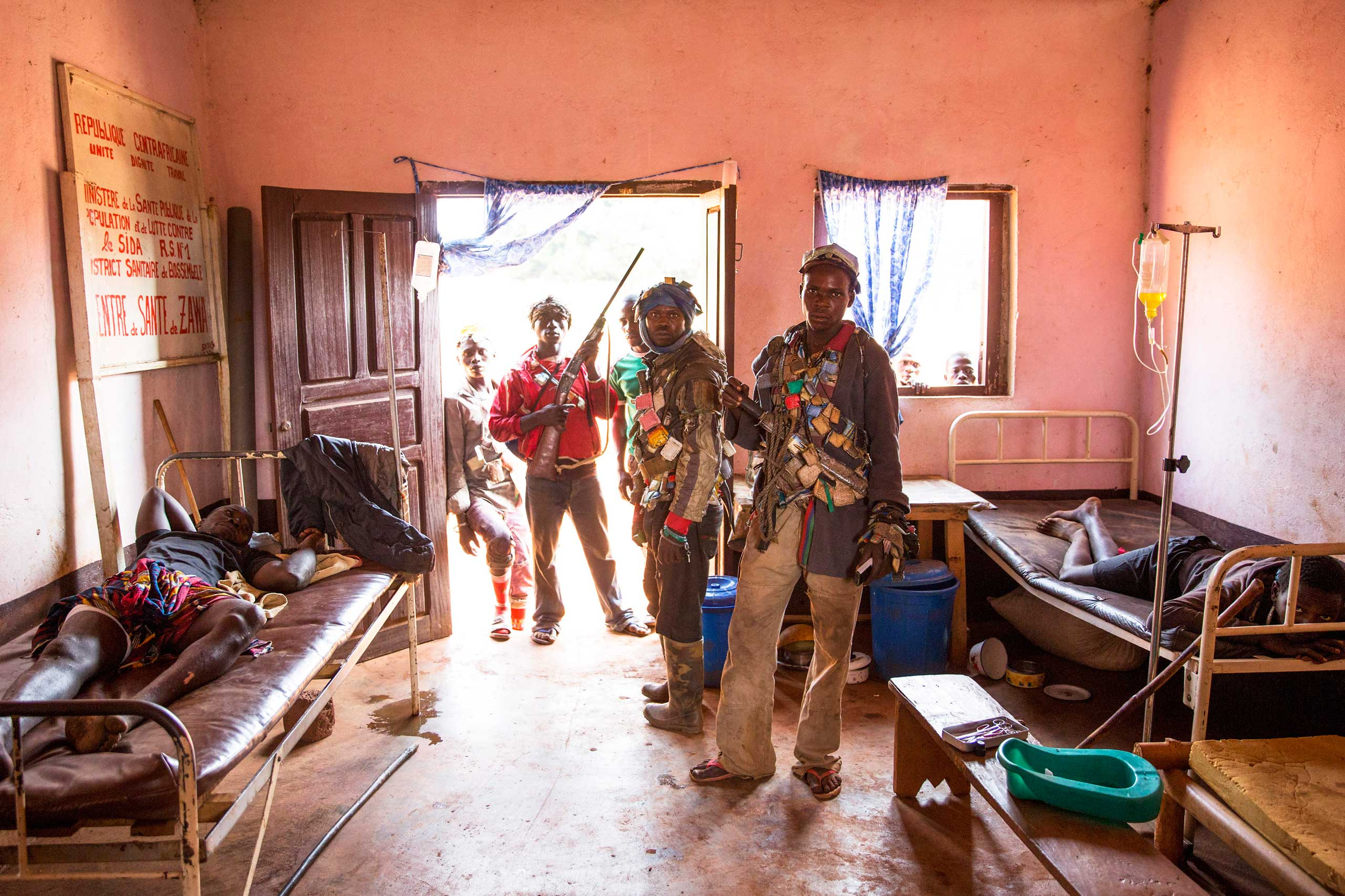 Jan 25. 2014: Anti-balaka in the medical center in Zawa, where some of their wounded comrades were being treated after fighting Séléka fighters.