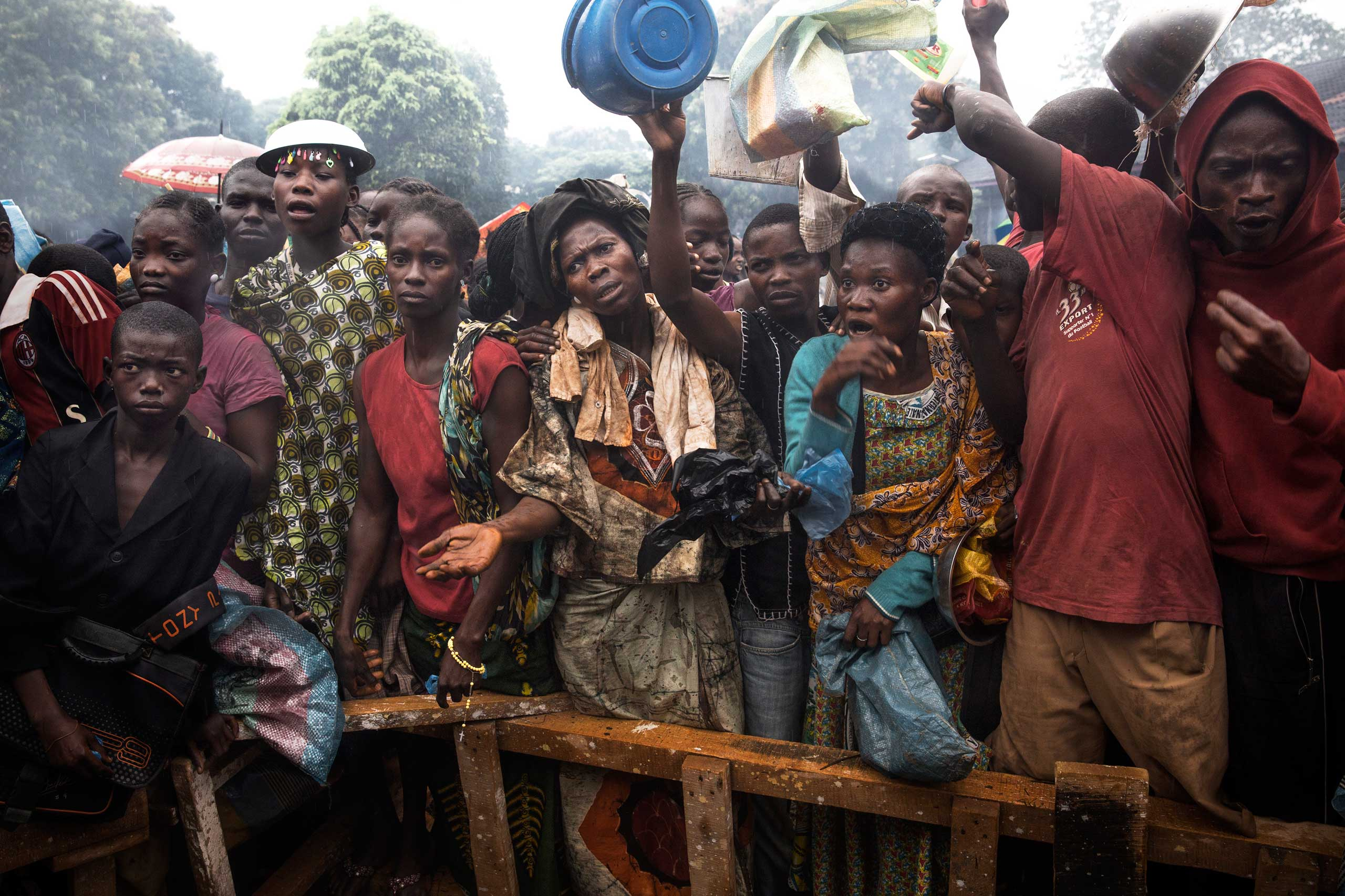 Dec. 9, 2013: Internally displaced people wait for food at the Don Bosco Center in Bangui. Some 18,000 Christians took refuge here.