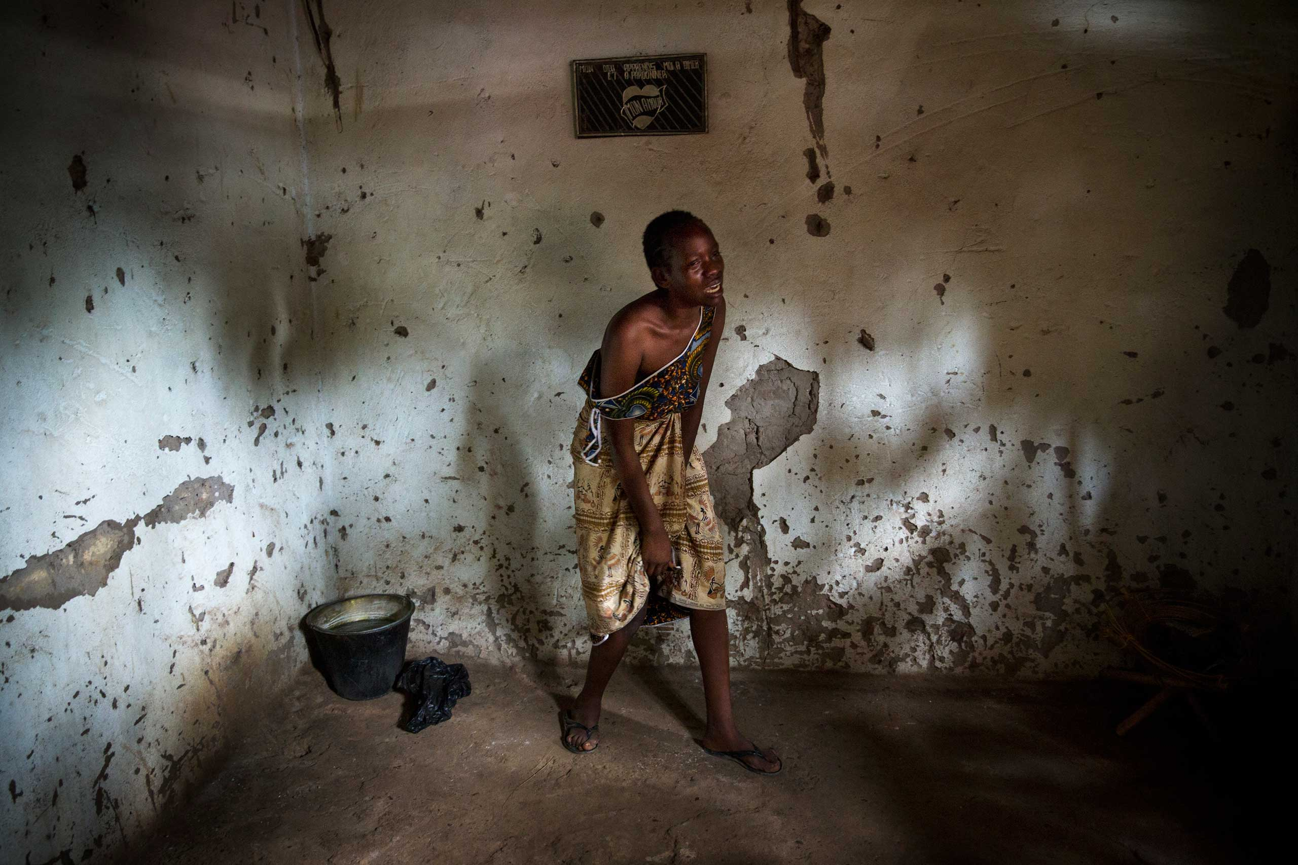 Dec. 9, 2013: A female relative grieves over the death of Sept-Abel Sangomalet, 20, who was allegedly stabbed by Muslims while sleeping at his family home in Bangui.