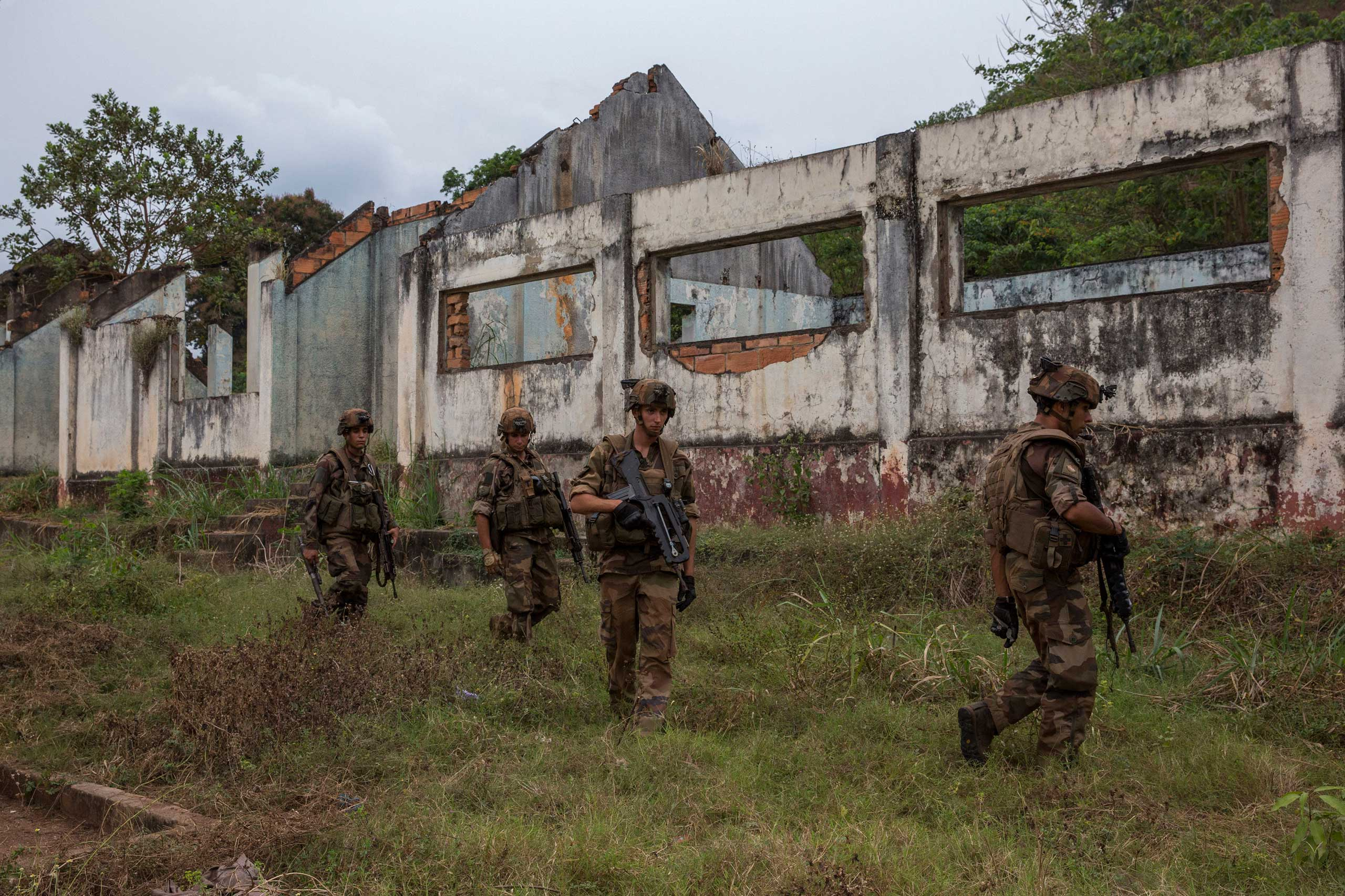 Jan. 28, 2014: After the last Séléka fighter left Camp Kasaï in Bangui, French troops look for weapons and ammunition.