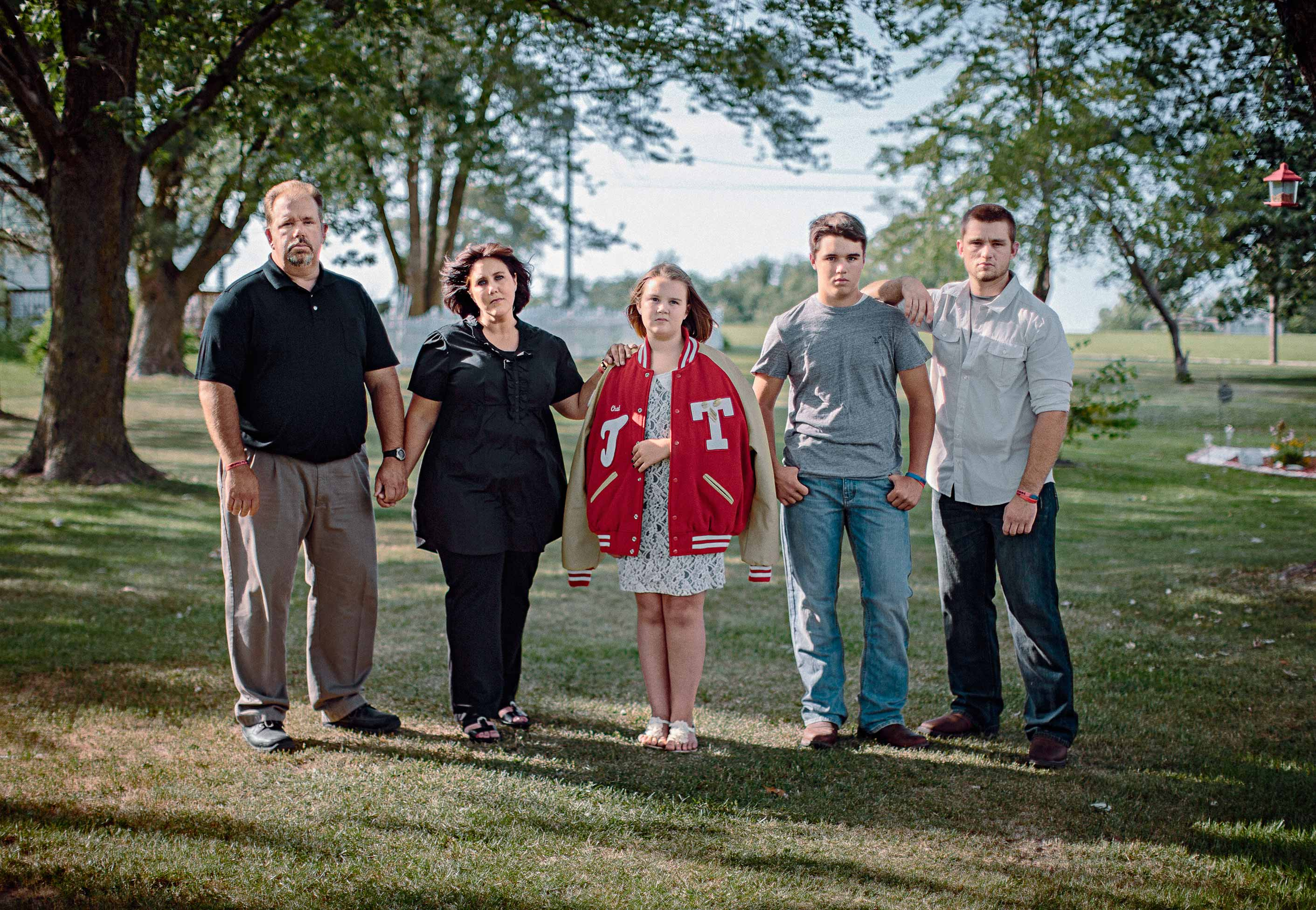 From left: Chad's father Ken, mother Amy and siblings Mandy, Kenton and Zane in the family's yard in central Missouri. Kenton, a high school freshman, has given up football