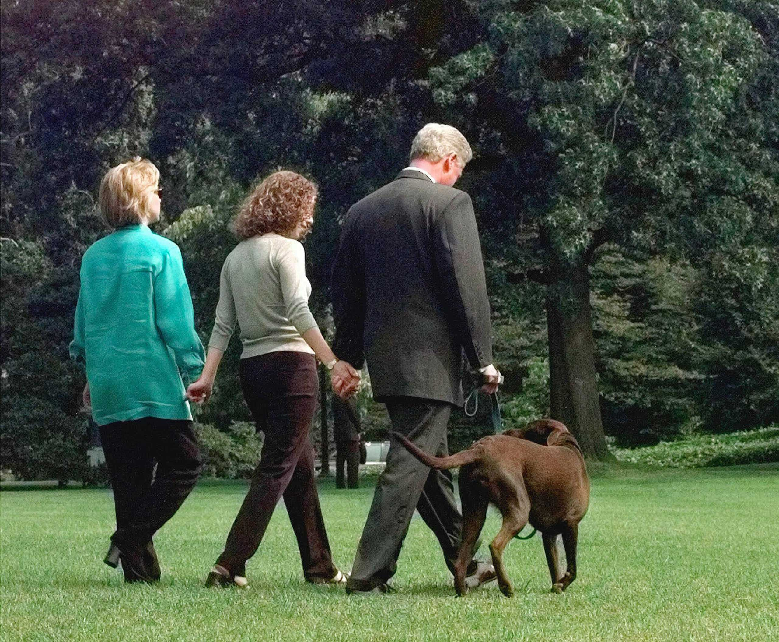 President Clinton, daughter Chelsea and first lady Hillary Rodham Clinton walk with their Labrador  Buddy  to board Marine One for a two week vacation, just after President Clinton confessed to a relationship with former White House intern Monica Lewinsky, in Washington, Aug. 18, 1998.