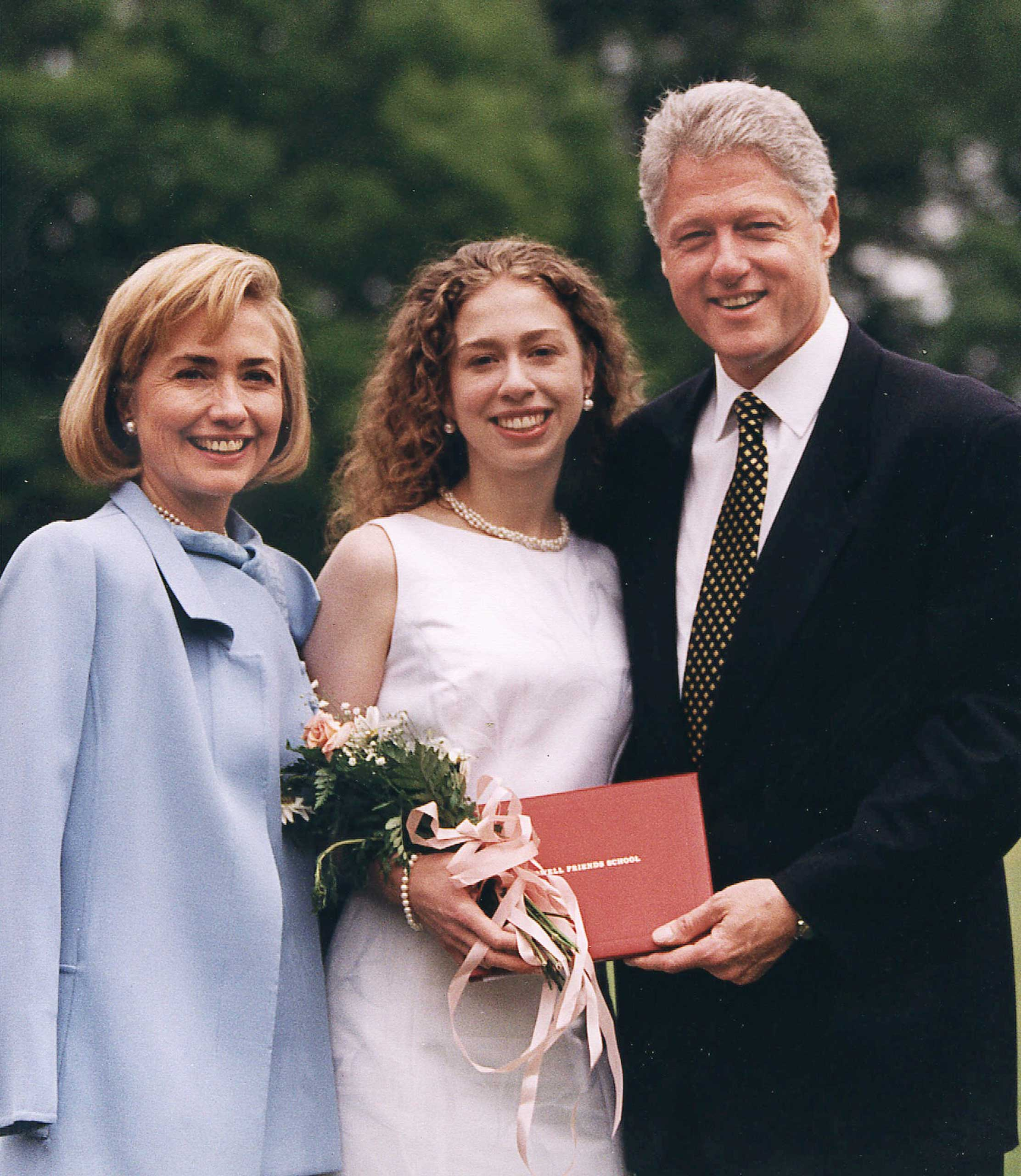 President and Mrs. Clinton stand with their daughter, Chelsea, after her high school graduation ceremony at Sidwell Friends School in Washington on June  6, 1997.