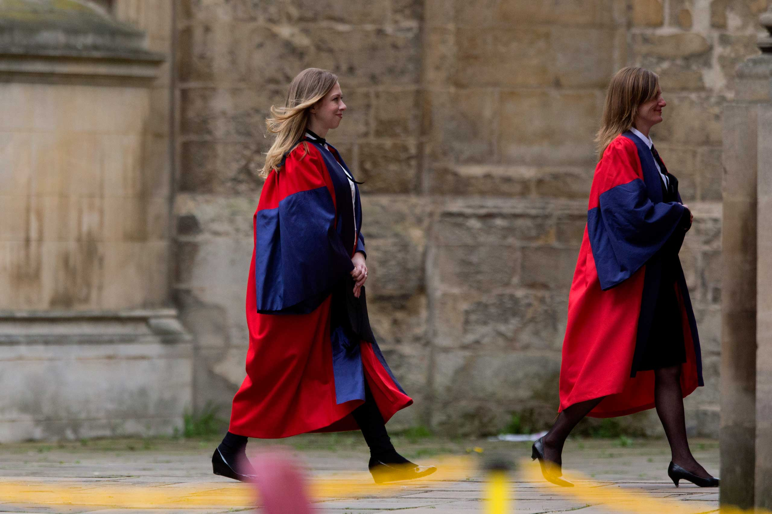 Chelsea Clinton, left, walks into her Oxford University graduation ceremony where she received her doctorate degree in international relations, at the Sheldonian Theatre in Oxford, England on May 10, 2014.