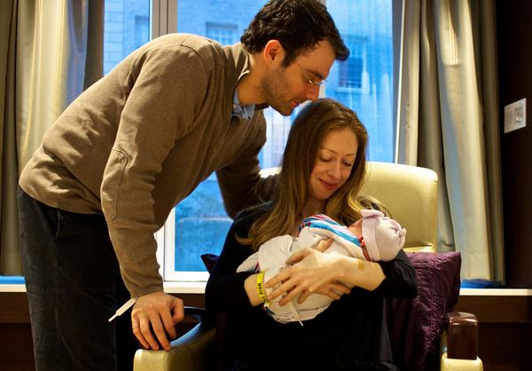 Chelsea Clinton and Marc Mezvinsky with their daughter Charlotte
