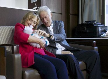 Hillary and Bill Clinton with their granddaugther Charlotte