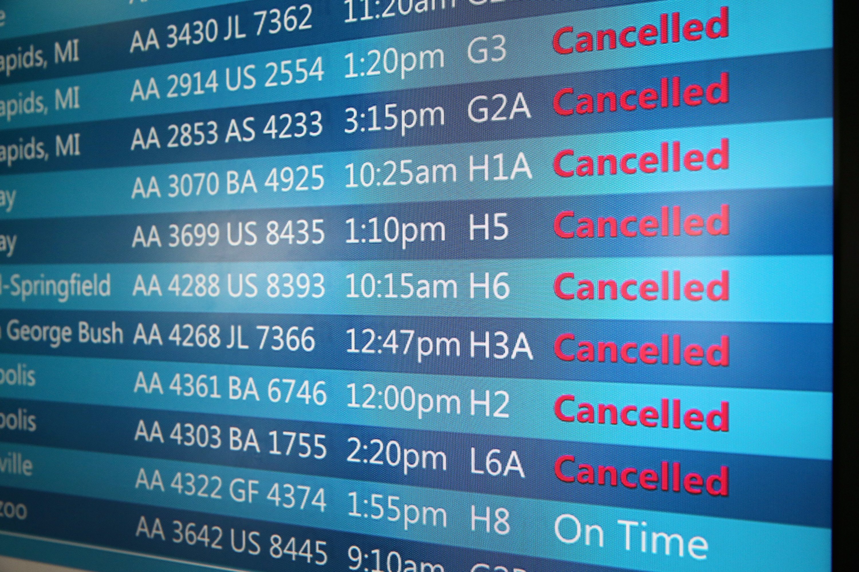 The arrival and departure display at O'Hare International Airport shows a list of cancelled flights on Sept. 27, 2014 in Chicago.