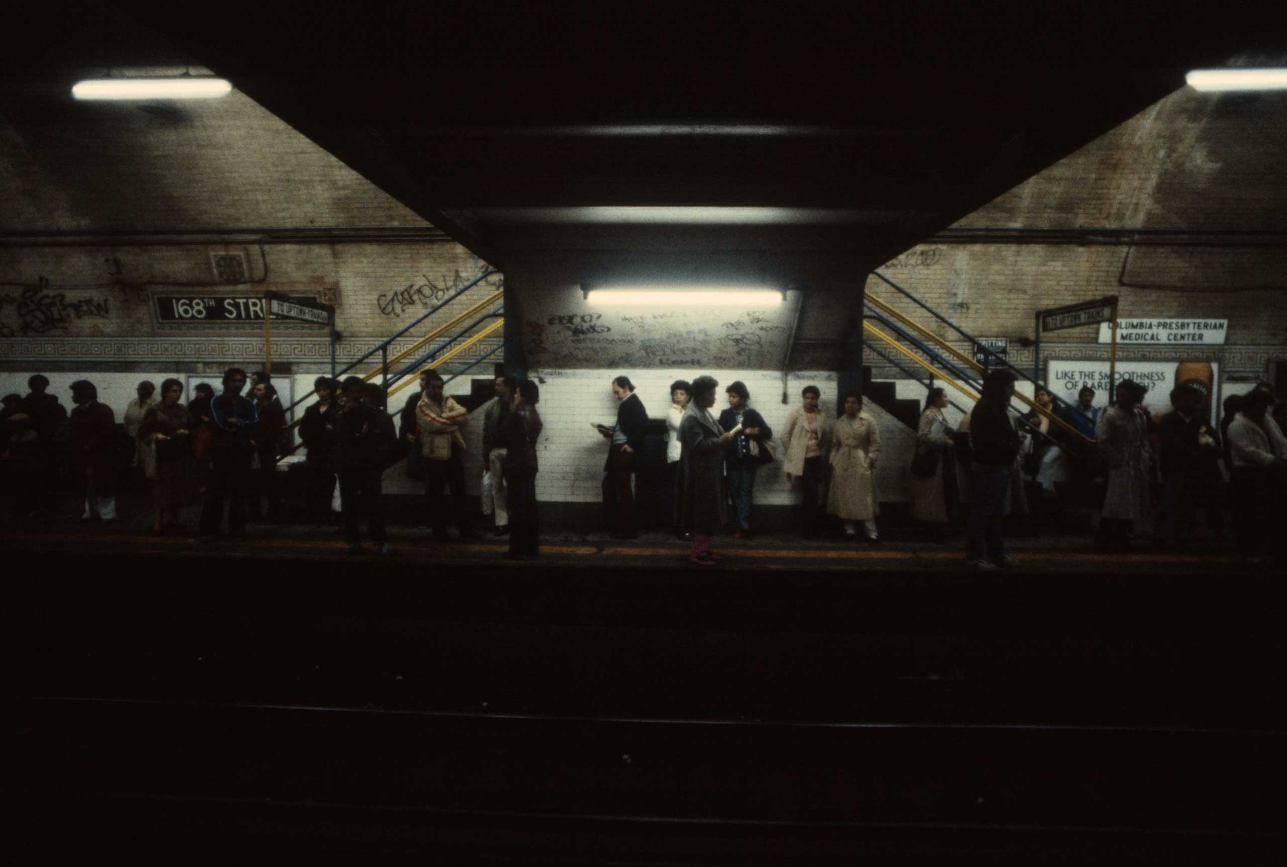 Commuters wait for a train at 168th Street station in Manhattan, 1981.
