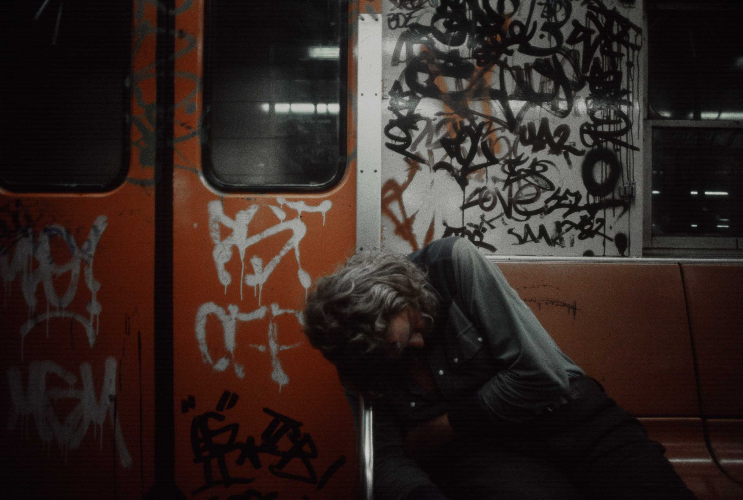 A man sleeps in a subway car, 1981.
