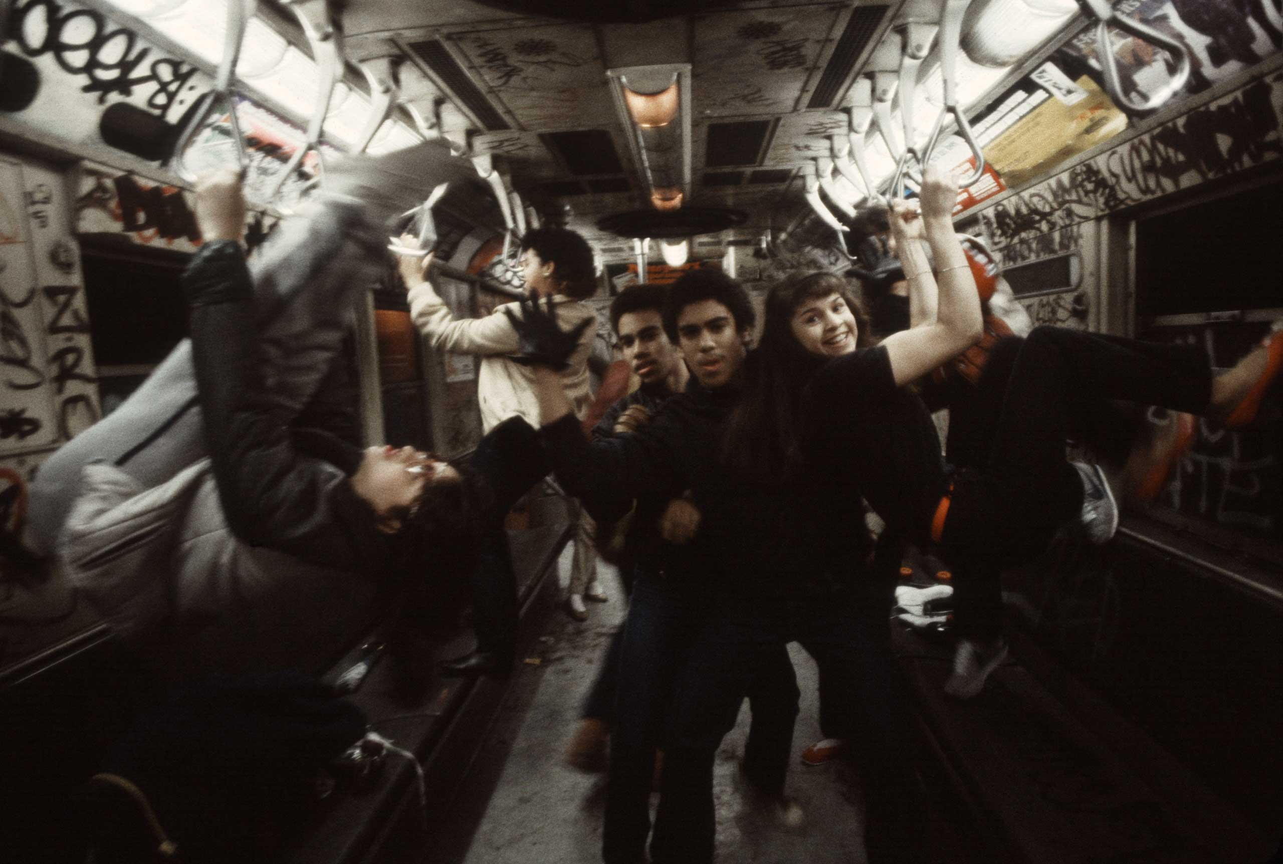 A group of teens pose on the 6 train in the South Bronx, 1981.